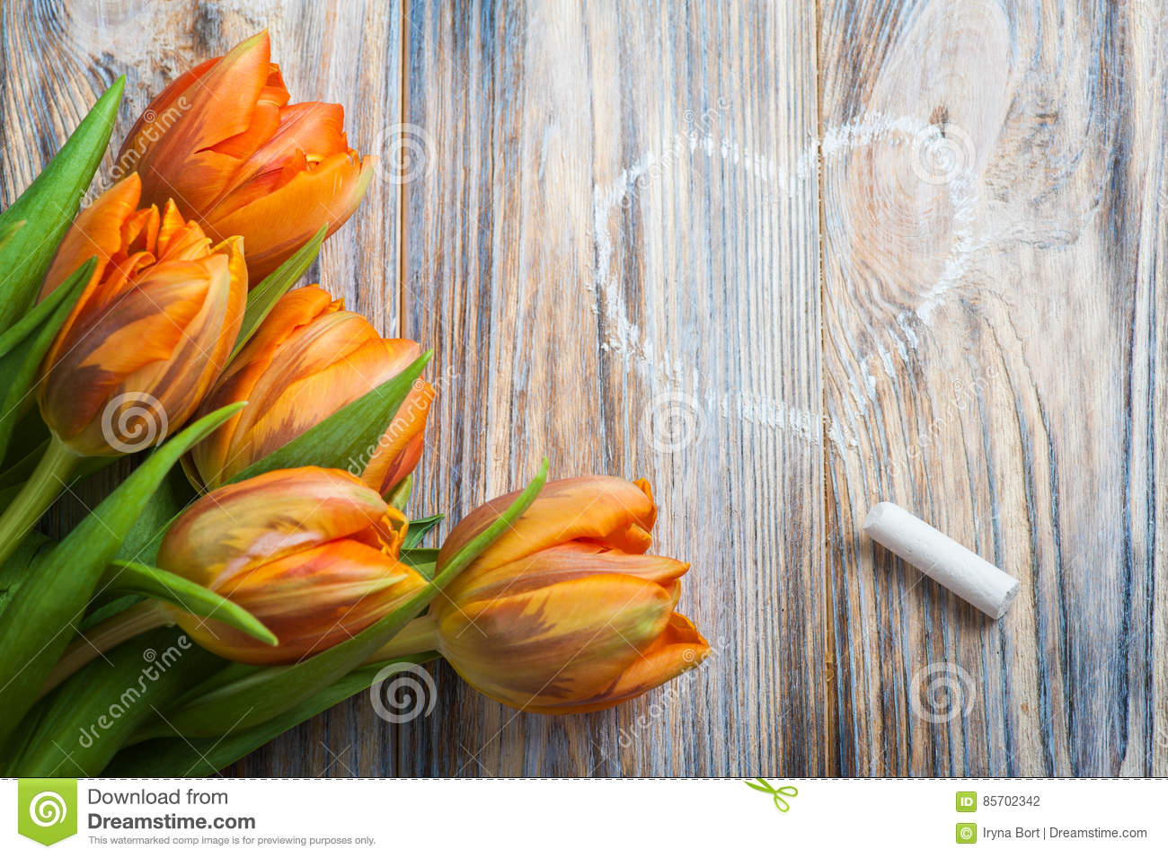 spring composition with orange tulips chalk and heart drawing stock