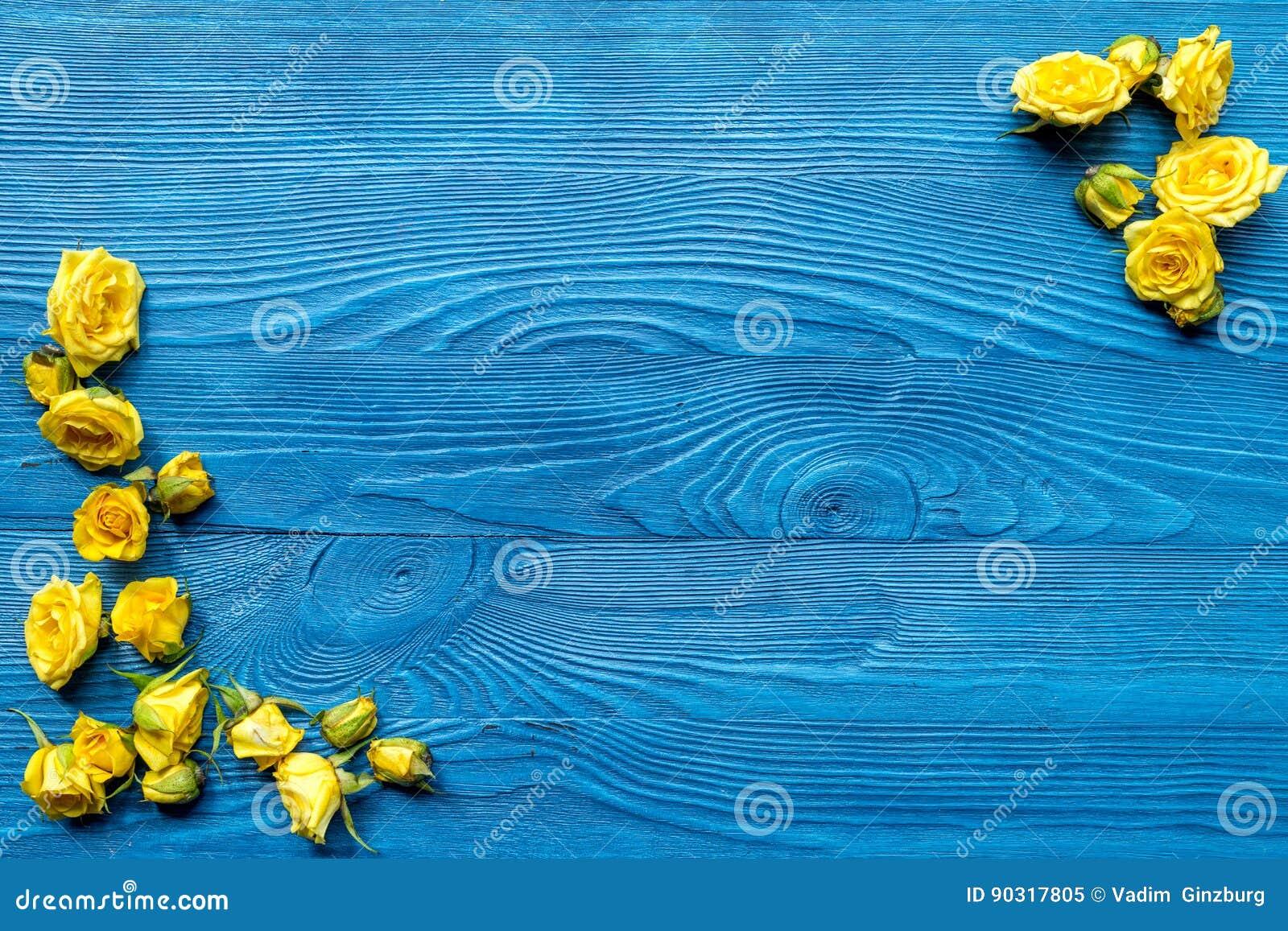 Wooden Desk With Blue Background ~ Spring design with roses on wooden desk background top