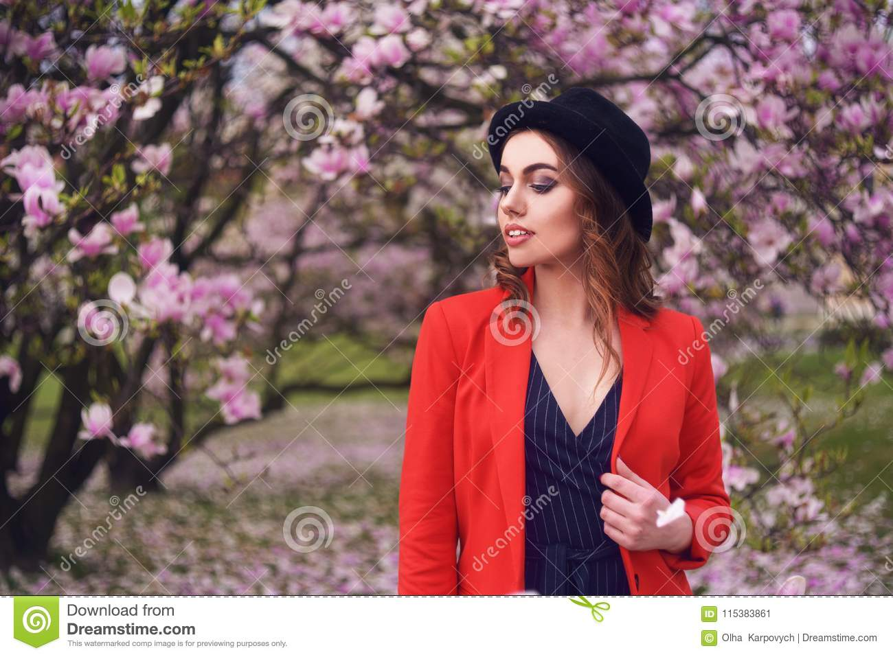 Spring fashion girl outdoors portrait in blooming trees. Beauty Romantic woman in flowers. Sensual Lady enjoying Nature.