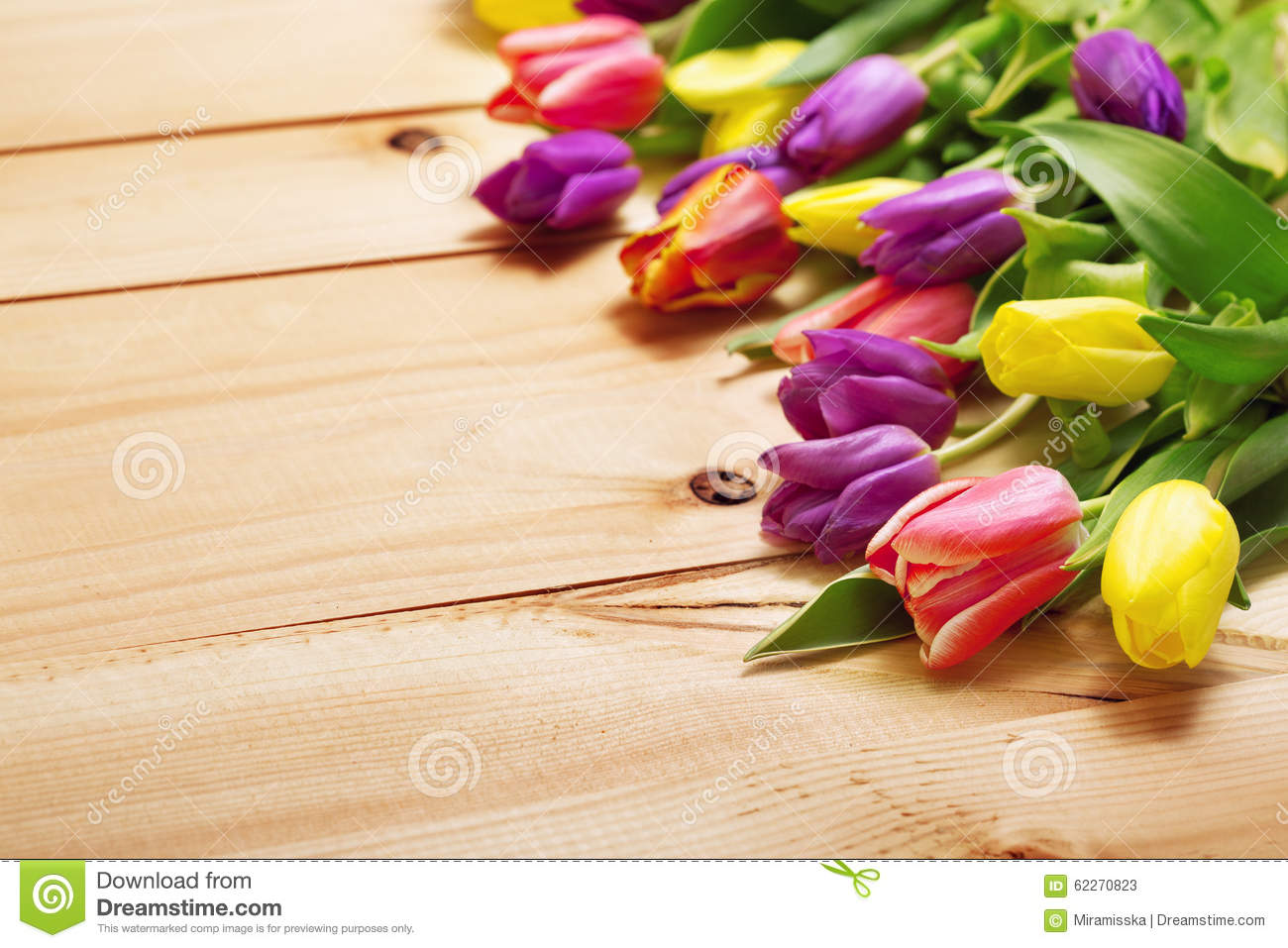Spring flowers bunch at wood floor texture beautiful tulips bou spring flowers bunch at wood floor texture beautiful tulips bou flower gift negle Images