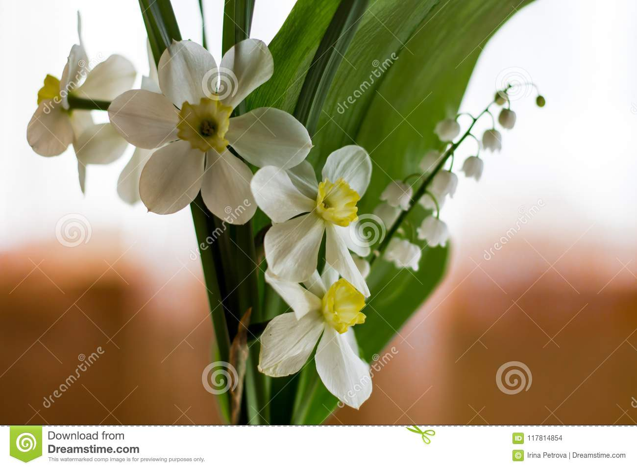 Spring Flowers Daffodils And Lilies Of The Valley In A Bouquet Stock