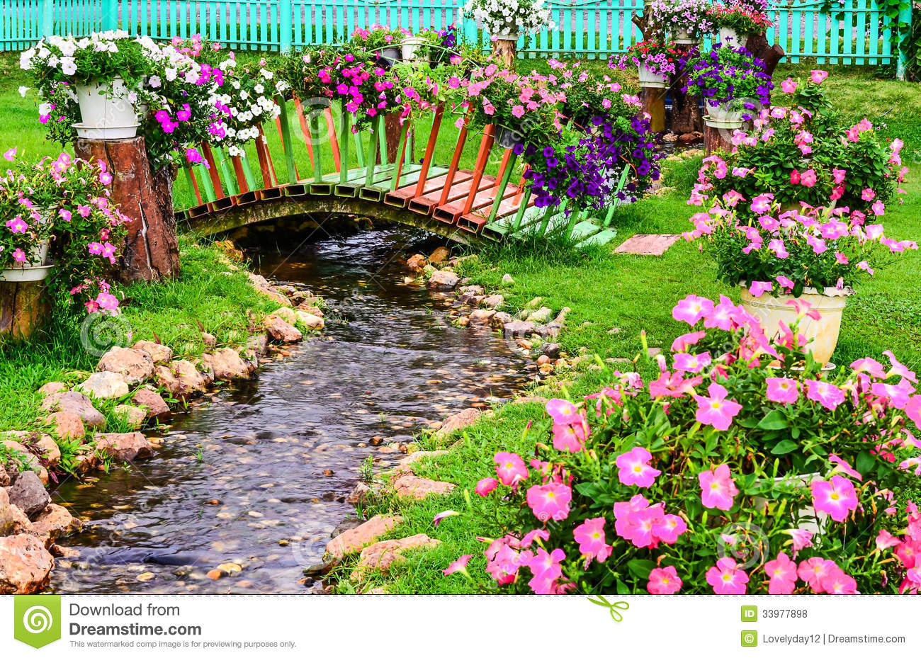 Spring flowers in garden with a pond stock photo image for Flower garden ponds