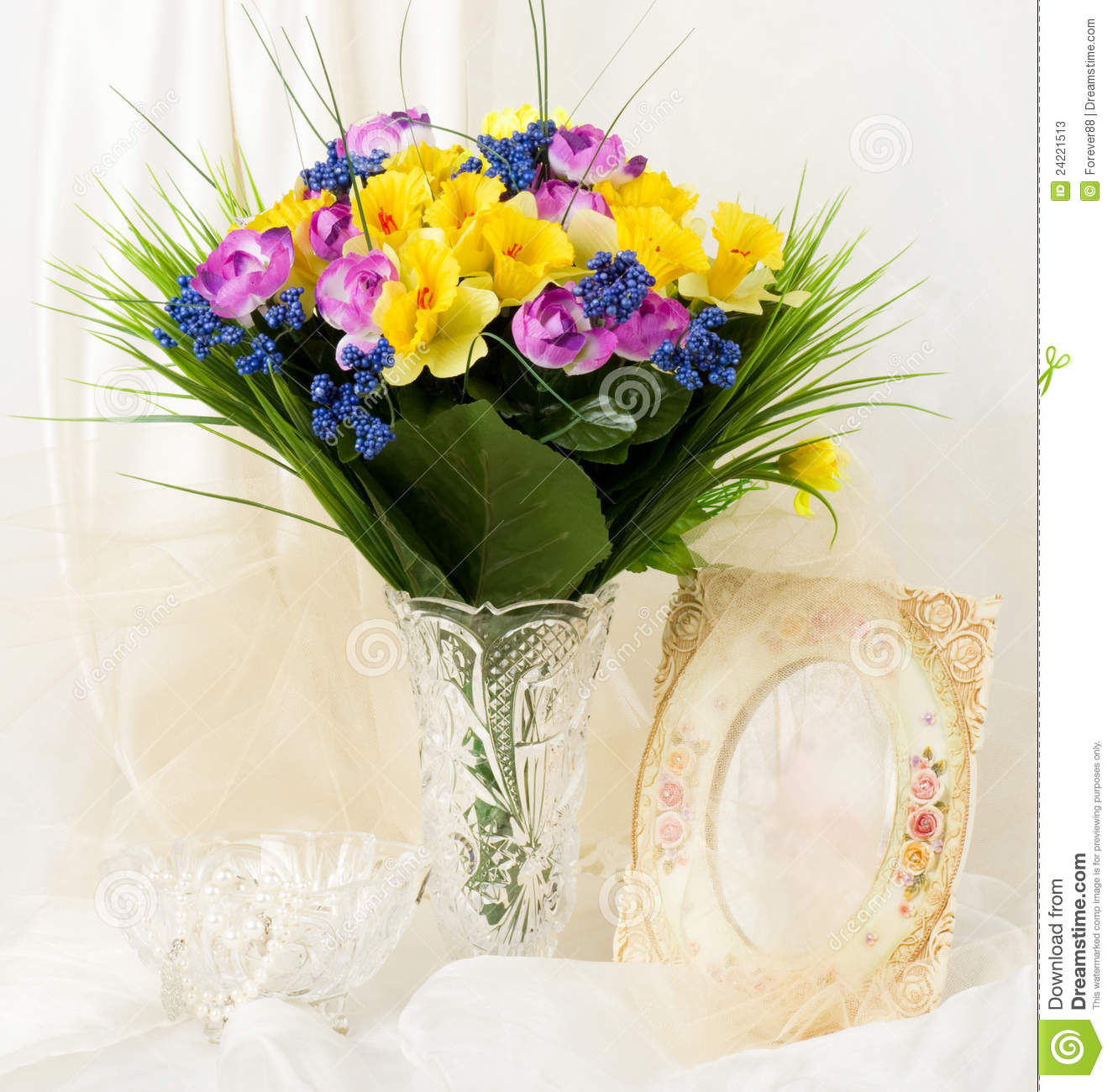 Spring Flowers In A Glass Vase And Frame Stock Image