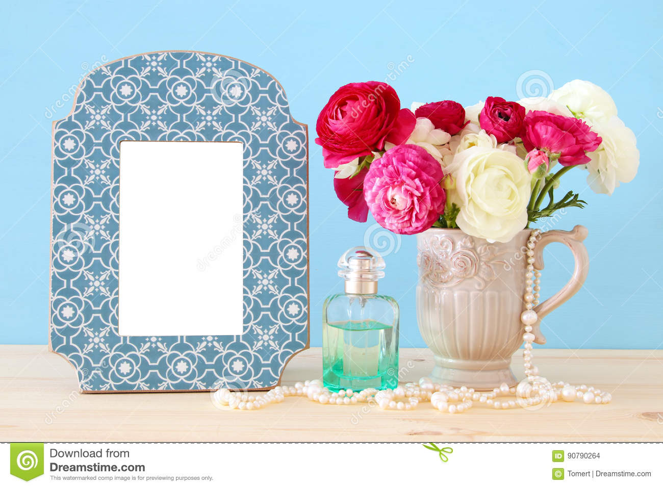Spring flowers perfume bottle and pearls next to blank vintage image of beautiful bouquet of spring flowers perfume bottle and pearls next to blank vintage photo frame on wooden table for photography mock up montage mightylinksfo