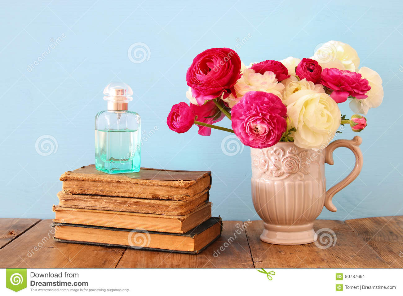 Spring flowers in the vase next to old books and perfume bottle spring flowers in the vase next to old books and perfume bottle mightylinksfo