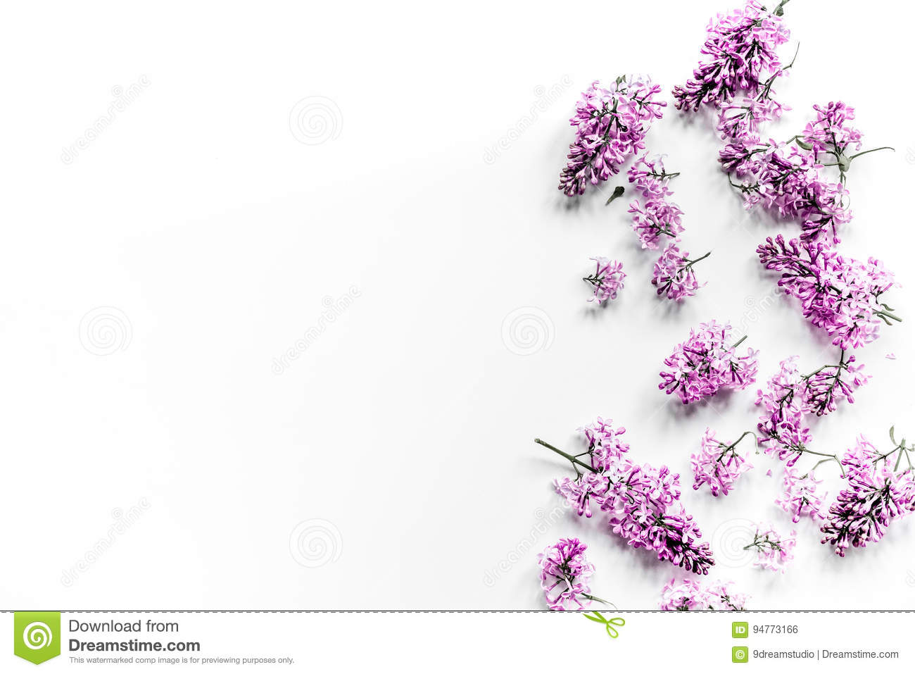 Spring lilac flowers on workdesk female home office white background top view mockup