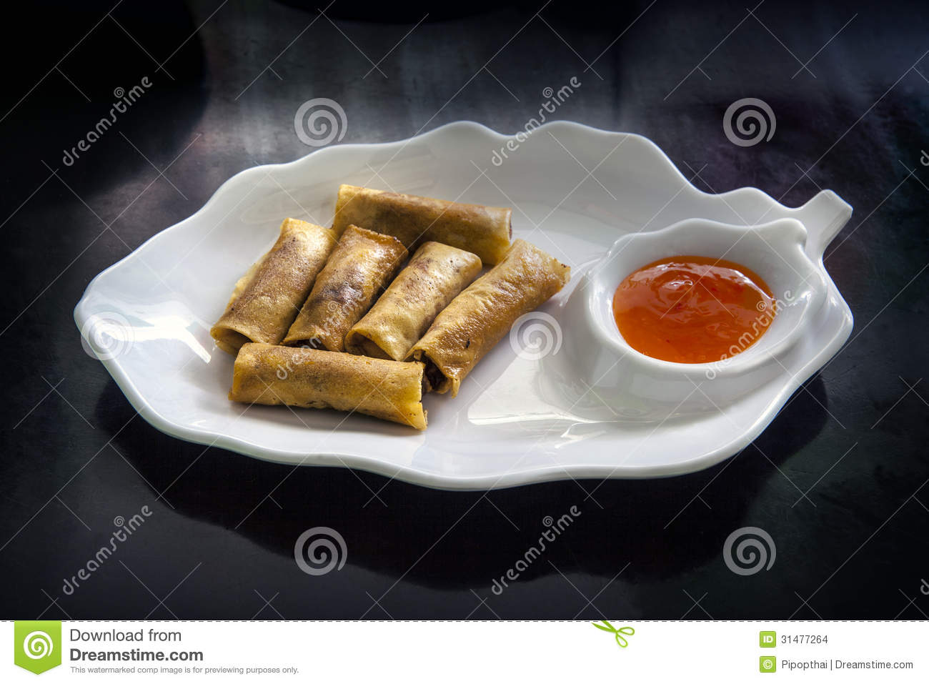 Spring rolls dim sum or loempia cuisine on the table for Cuisine translate