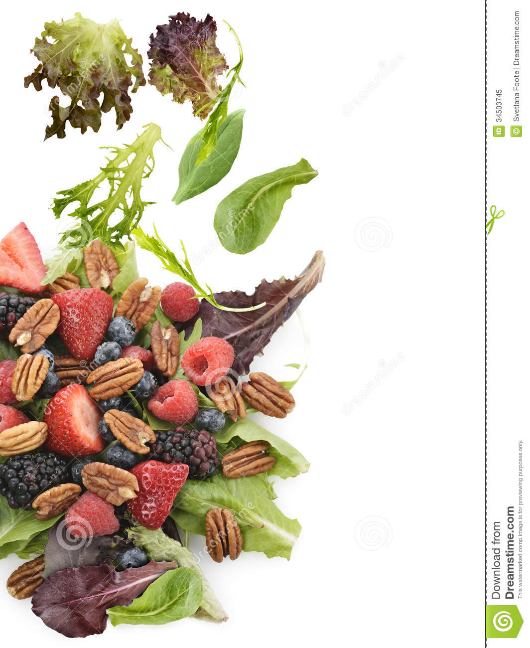 Spring Salad With Berries And Peanuts On White Background.