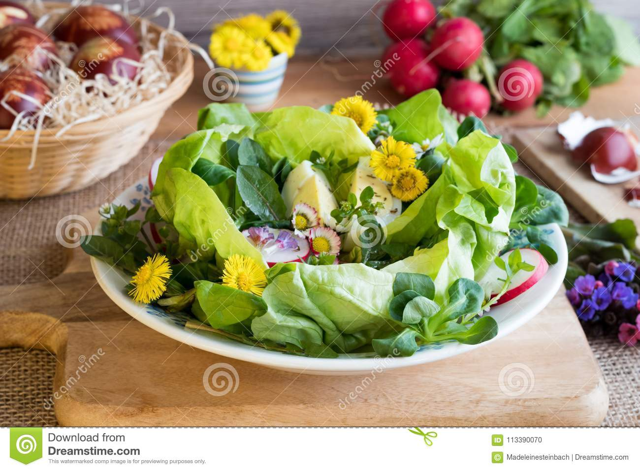 Spring salad with eggs and wild edible plants