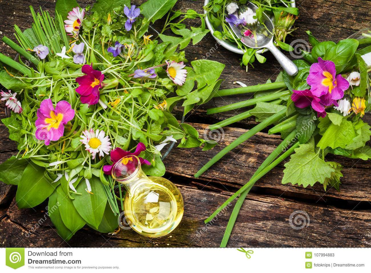 Spring salad wild herbs edible flowers and oil stock image spring salad wild herbs edible flowers and oil mightylinksfo