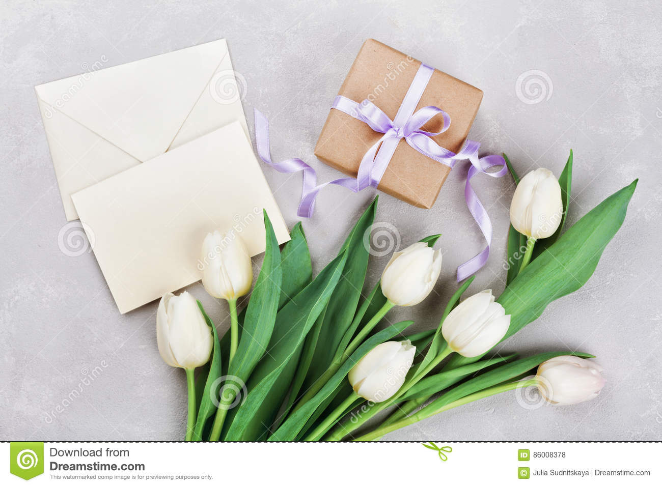 Spring tulip flowers gift box and paper card on gray stone table royalty free stock photo download spring tulip flowers gift negle Images