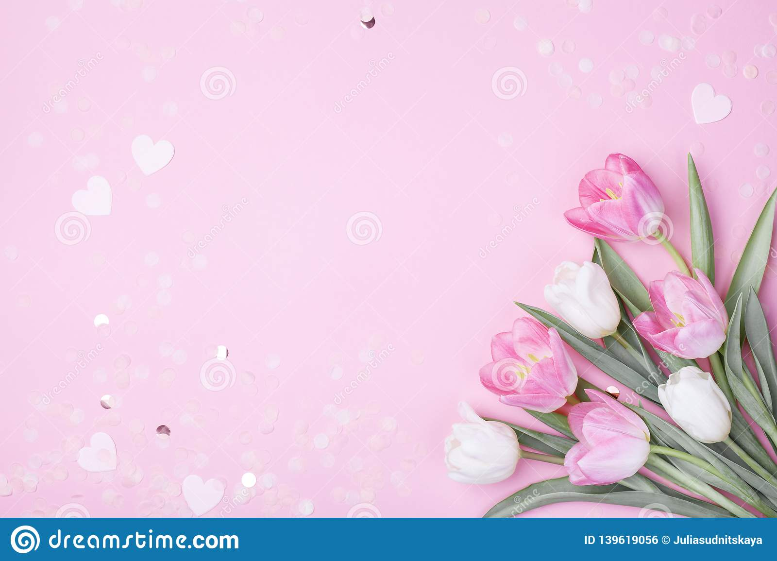 Spring tulip flowers on pastel pink background top view. Greeting card for International Women Day, Mother day. Flat lay