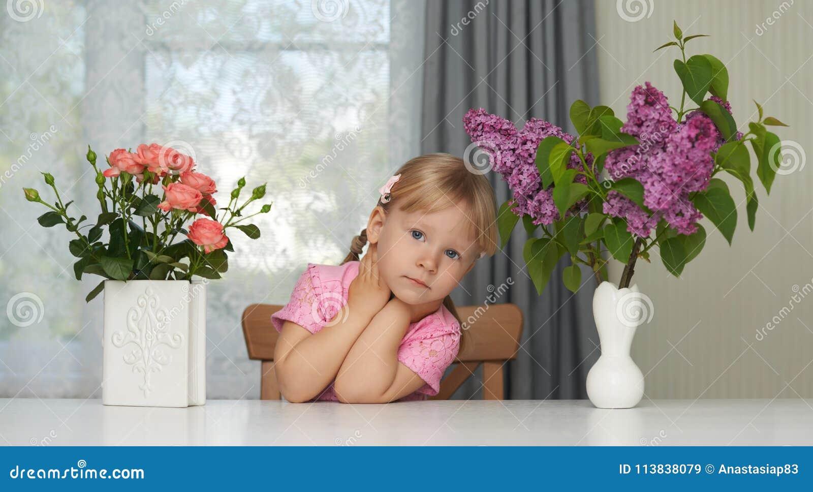 Spring violet flower portrait of a dreaming girl