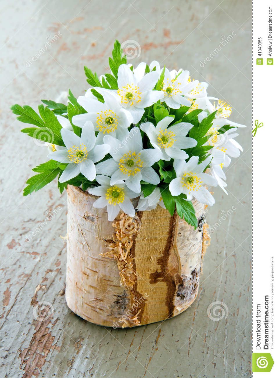 spring wild flowers in a wooden cup stock photo image of rustic