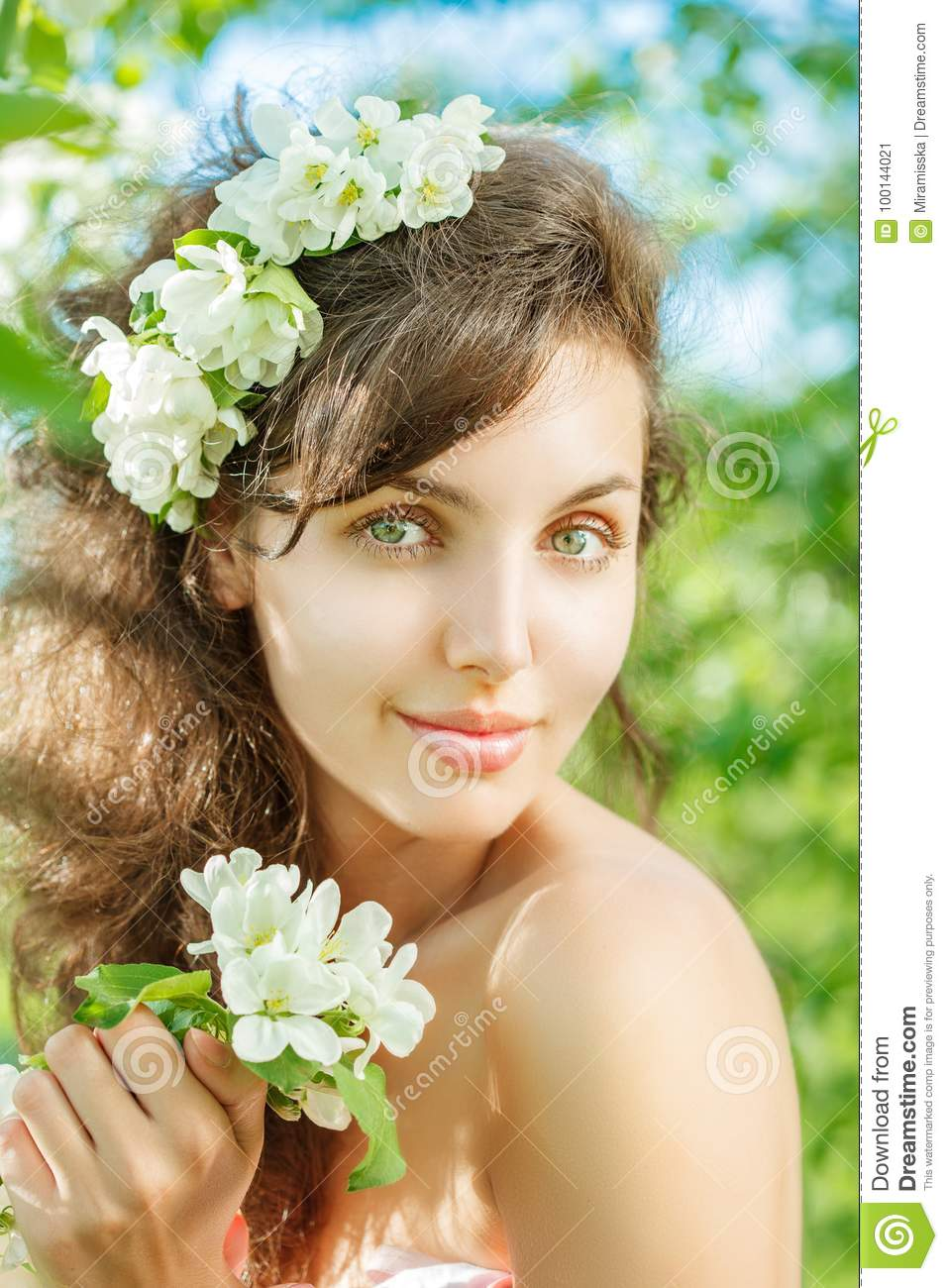 Spring Woman.Beautiful Girl model with spring flowers. Young Fem