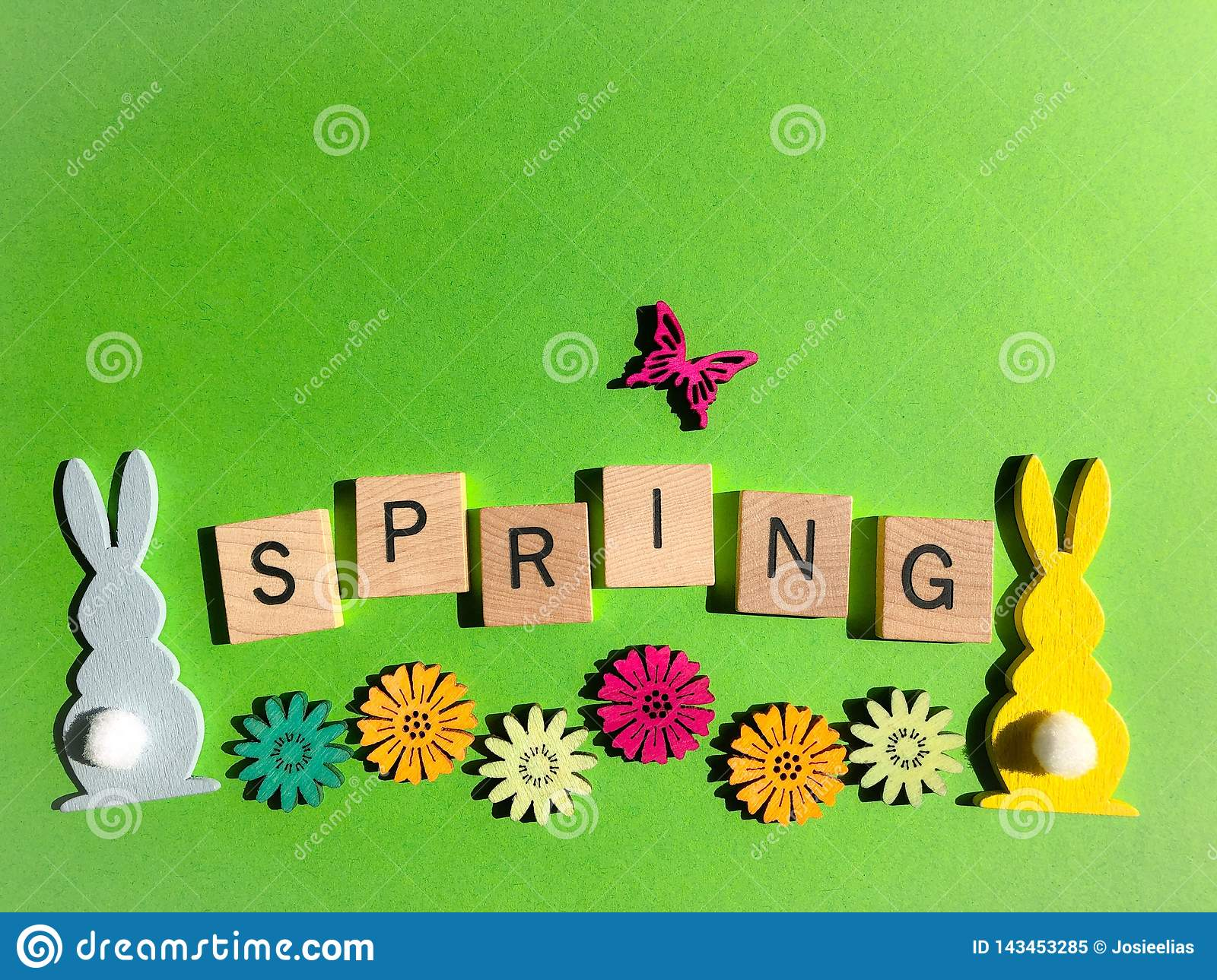 Creative concept : the word Spring in 3d wooden alphabet letters