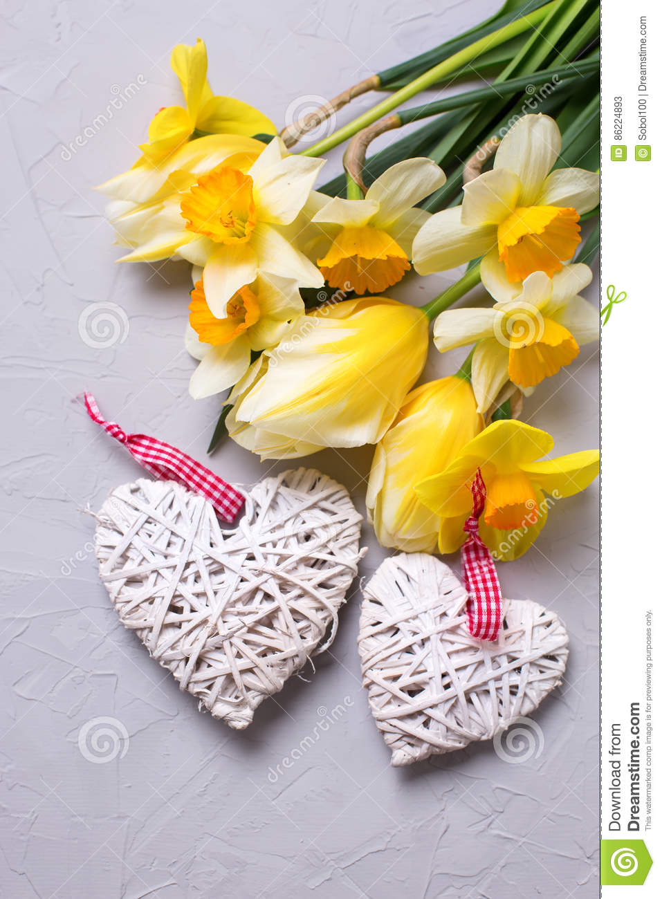 Spring Yellow Flowers And Two Decorative Hearts On Grey Texture