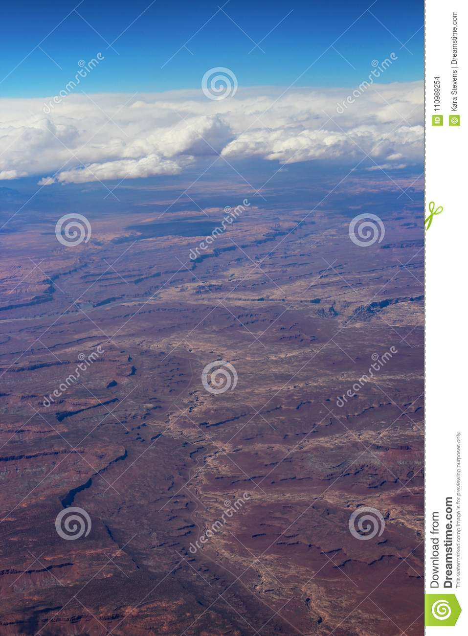Flight Over Clouds And Canyons With View Of Curvature Of The Earth