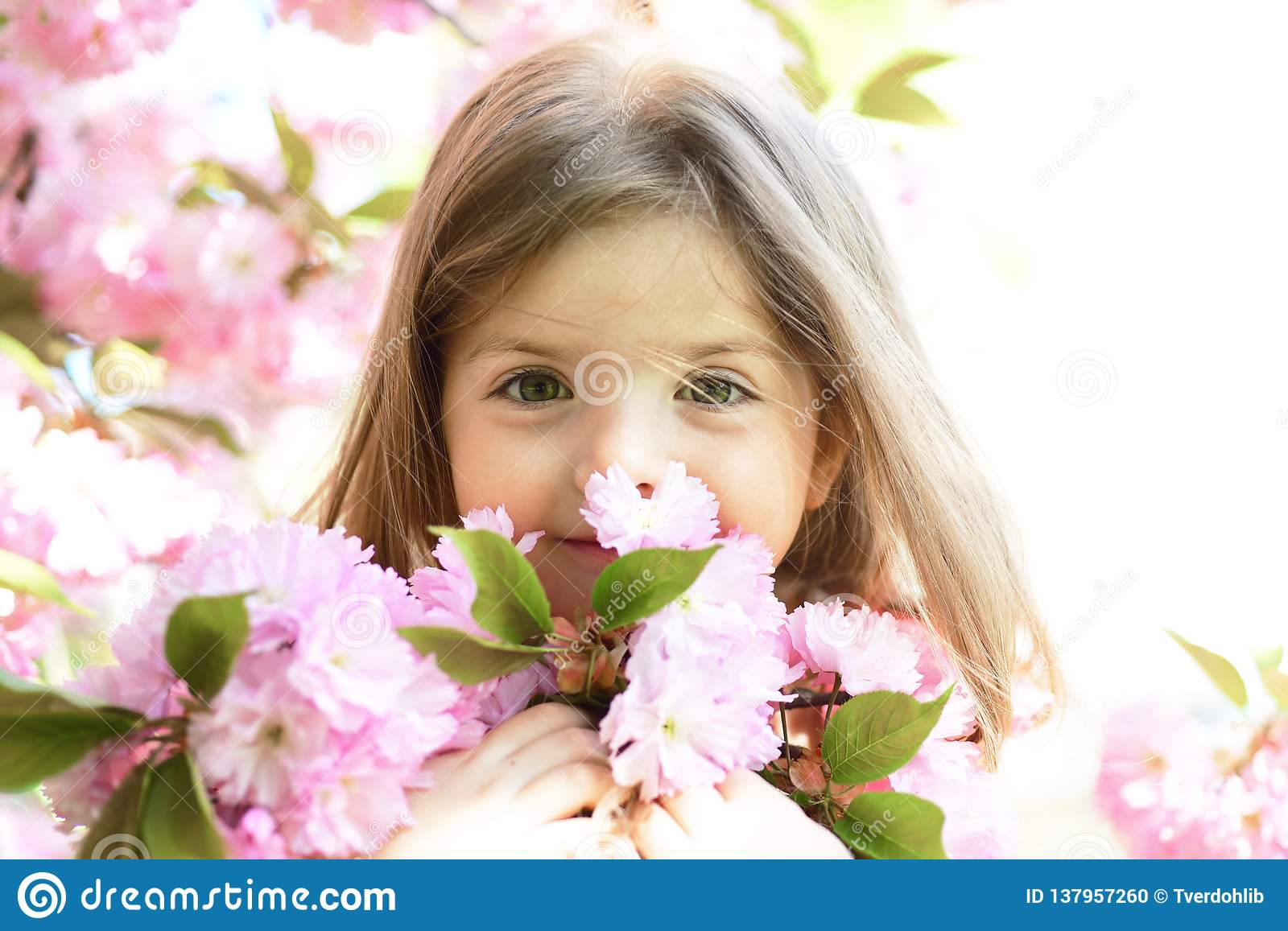Springtime. weather forecast. Little girl in sunny spring. face and skincare. allergy to flowers. Summer girl fashion