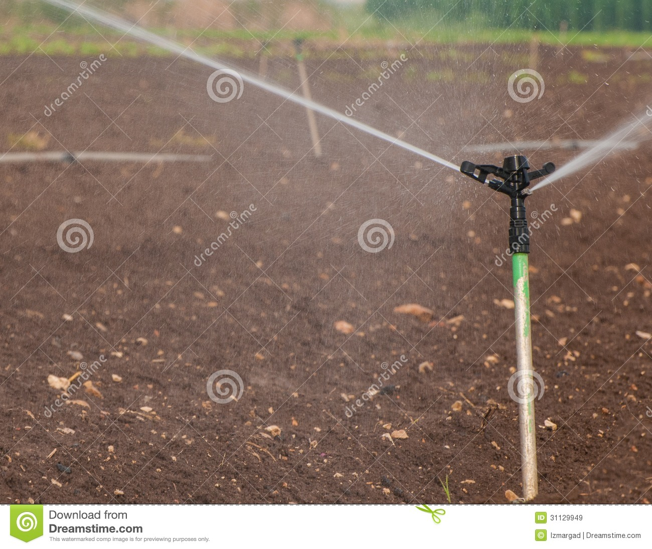 Sprinkler irrigation system close up royalty free stock for Soil as a system