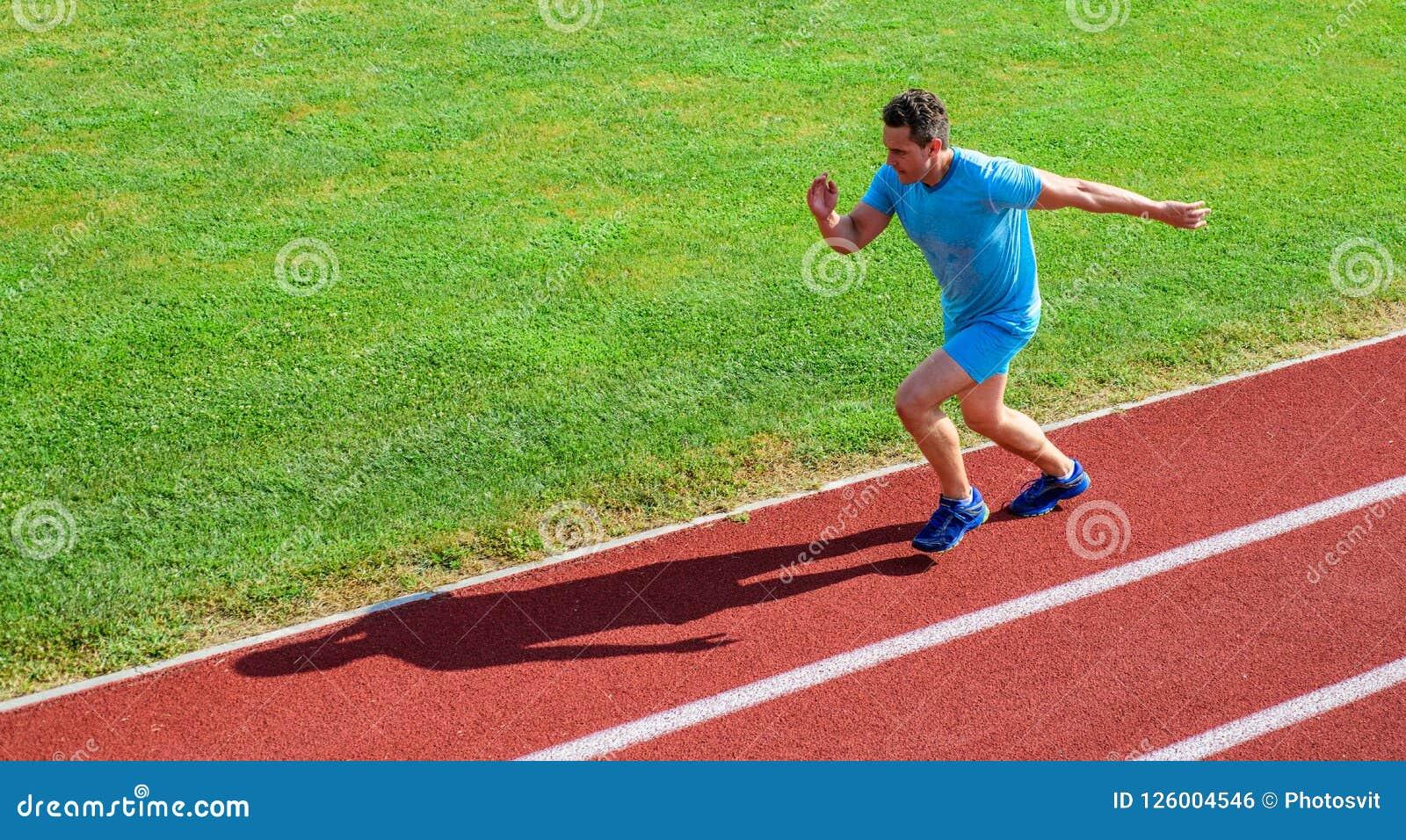 2642e00d48 Sprinter training at stadium track. Runner captured in midair. Short  distance running challenge. Boost speed. Athlete run track grass background.