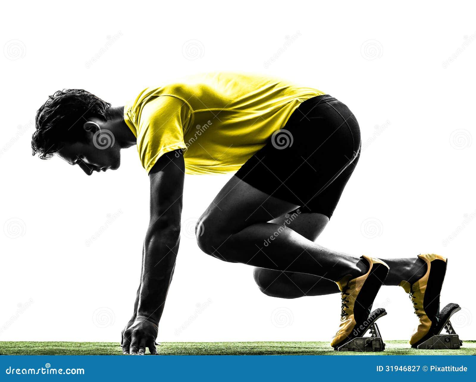 Sprinterlöpare för ung man i startgropkontur