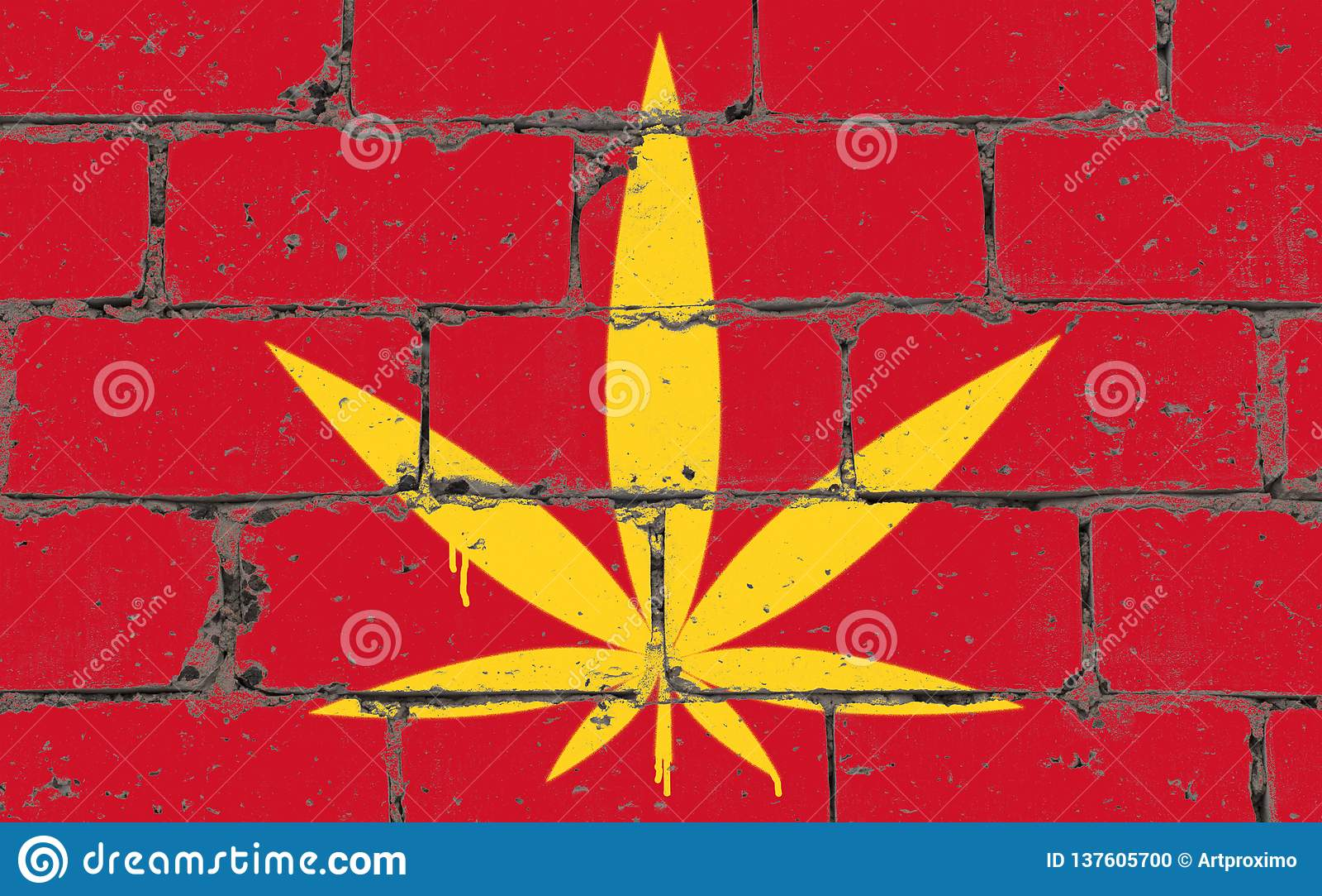 Spruzzo di arte della via dei graffiti che attinge stampino Foglia della cannabis sul muro di mattoni con la bandiera Vietnam