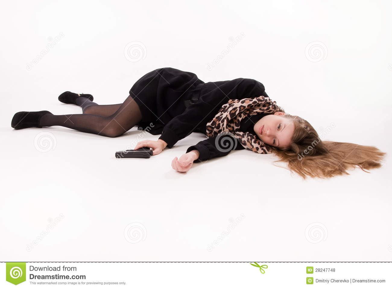 Spy girl with gun lying on the floor royalty free stock for On the floor
