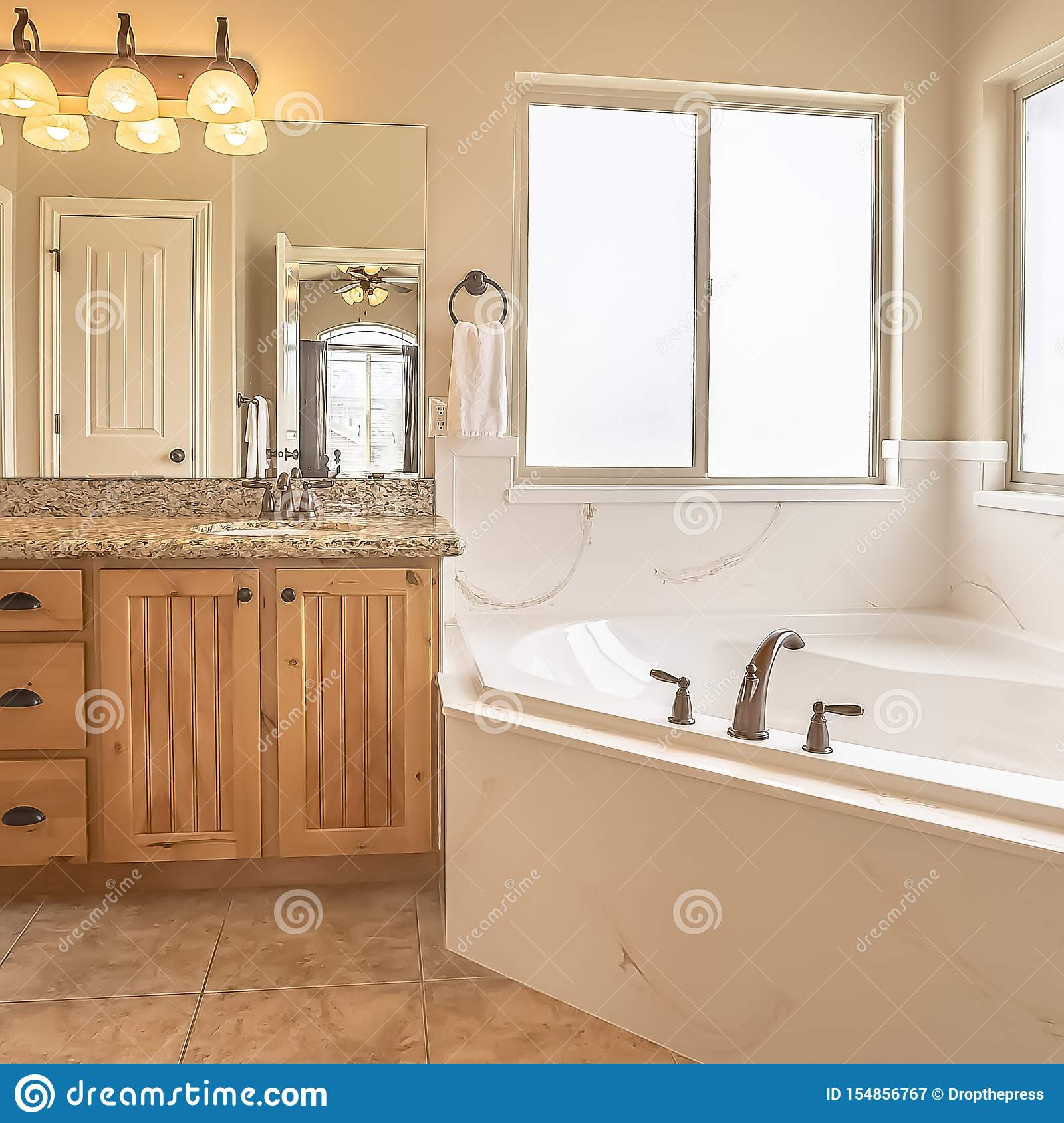Square Built In Bathtub At The Corner Of A Home Bathroom With Tile Floor And Beige Wall Stock Image Image Of Sink Architecture 154856767