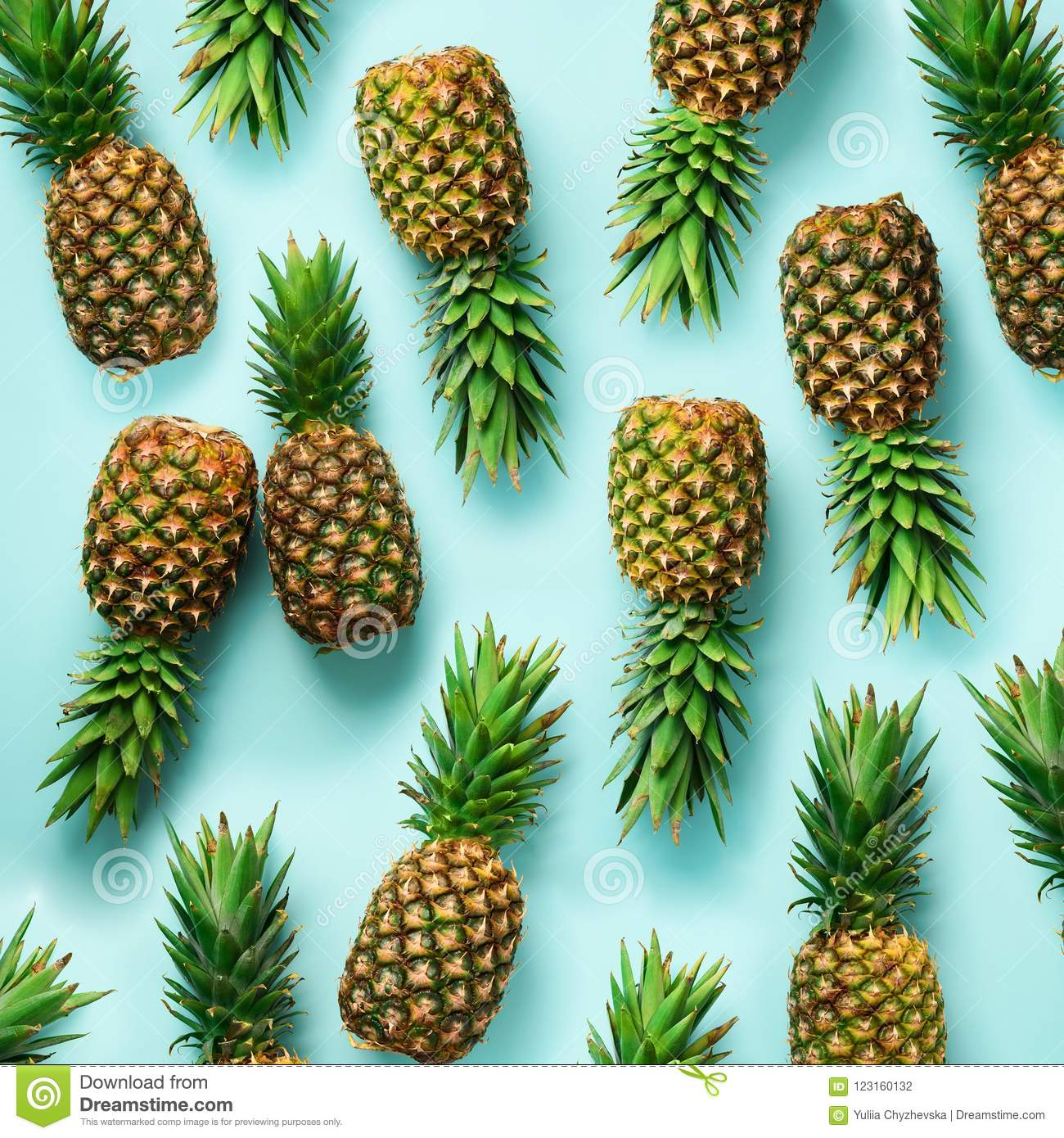 Square crop. Fresh pineapples on blue background. Top View. Pop art design, creative concept. Copy Space. Bright
