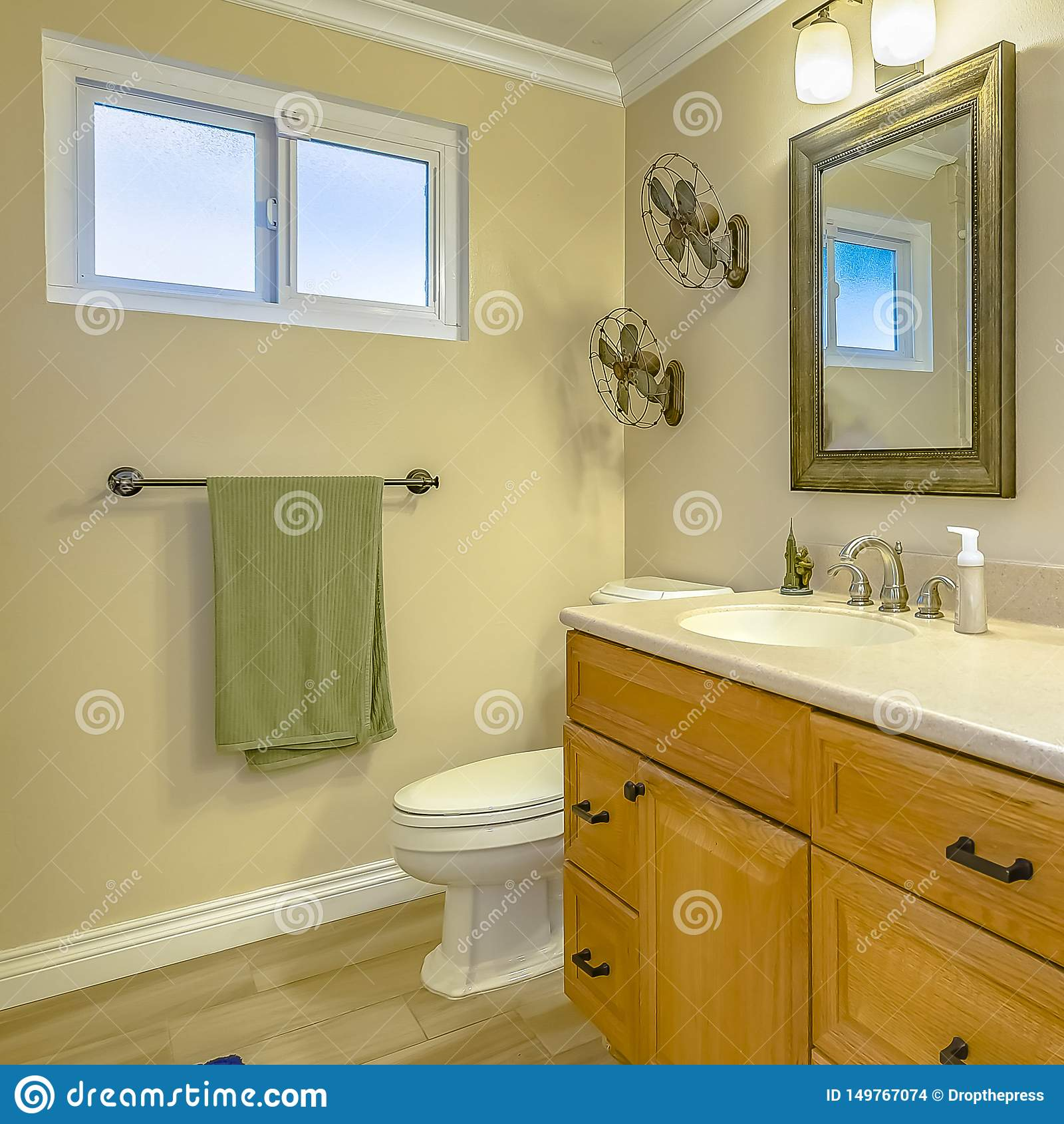 Square Double Vanity With Wooden Cabinets Inside A Bathroom With Small Window Stock Photo Image Of Fixture Design 149767074