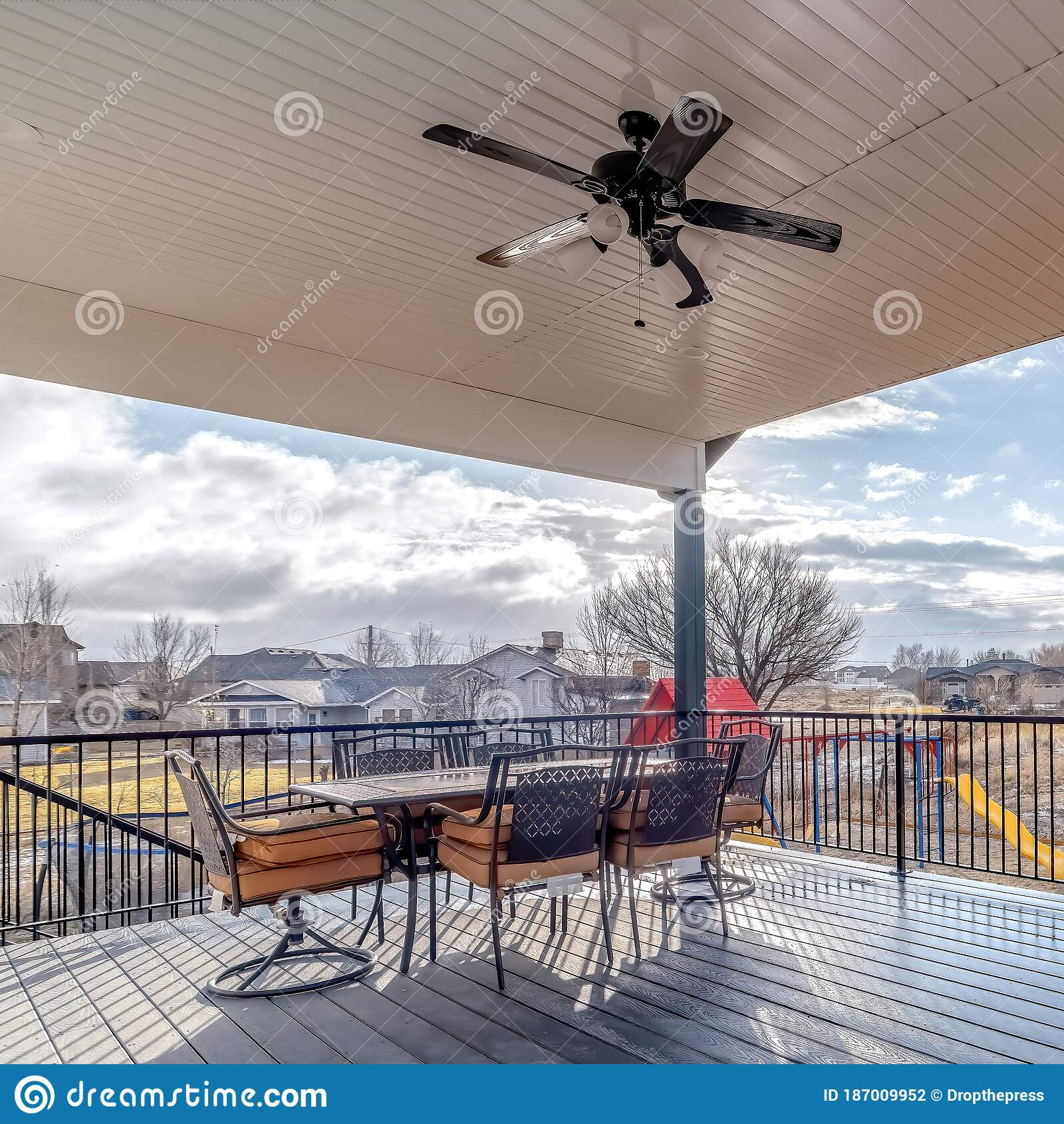 Square Frame Dining Table Chairs And Ceiling Fan With Light On Wooden Deck With Metal Railing Stock Photo Image Of Residence Homes 187009952