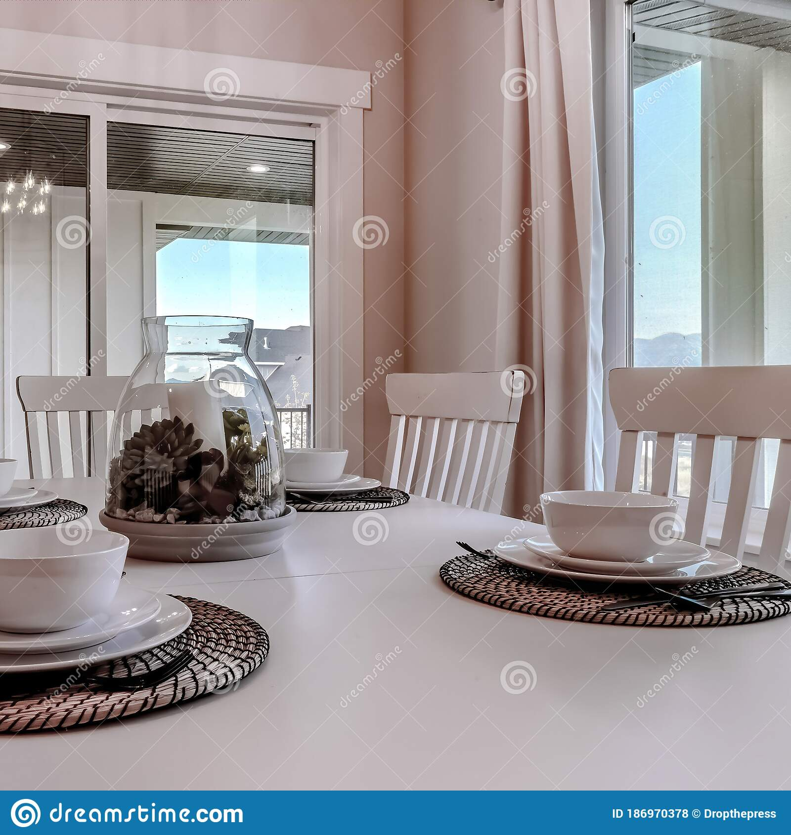 Square Frame Dining Table With Chairs And Tableware Arranged Around A Decorative Centerpiece Stock Photo Image Of Room Residential 186970378