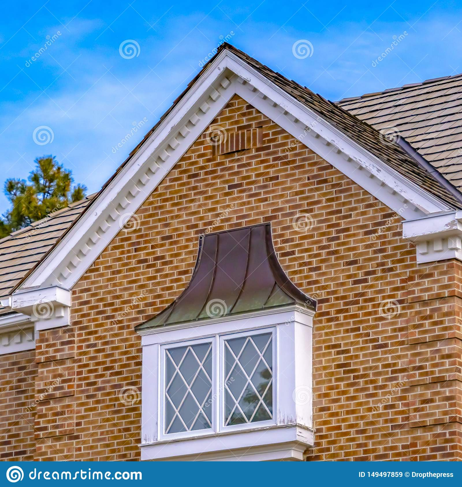 square frame luxurious exterior house lush trees serene sky background features classic brick wall windows white 149497859