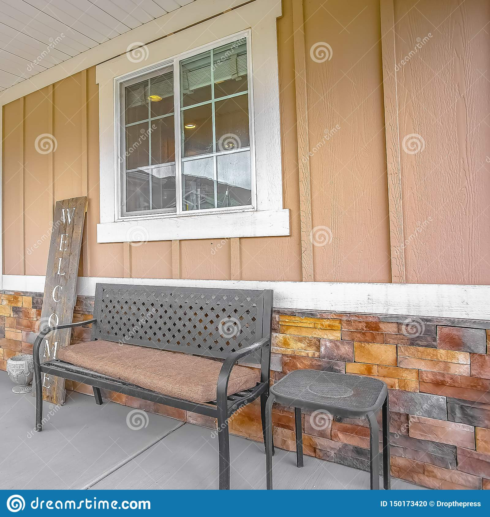 Fine Square Front Porch Of A Home With A Bench And Stool In Front Spiritservingveterans Wood Chair Design Ideas Spiritservingveteransorg