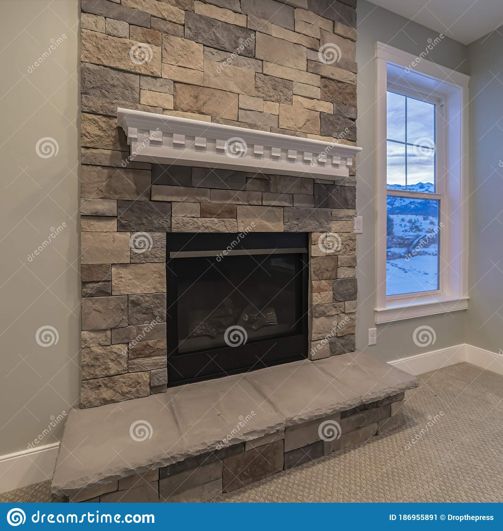 Picture of: Square Modern Fireplace And Decorative Shelf Against Stone Brick Accent Wall Of Home Stock Image Image Of Residence Real 186955891
