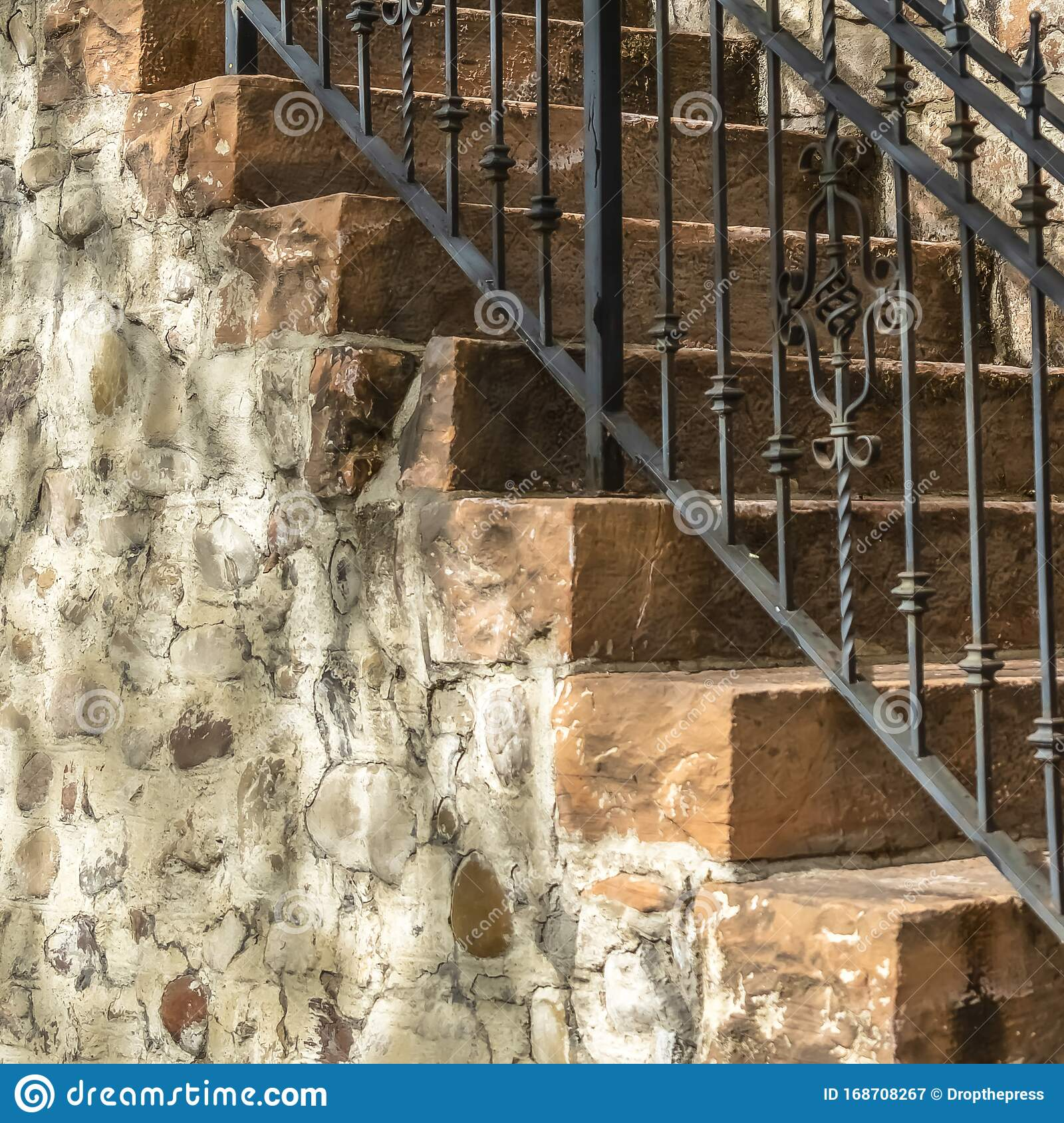 Square Outdoor Staircase With Stone Steps And Black Metal Railing Against A Fence Stock Image Image Of Architectural Metal 168708267
