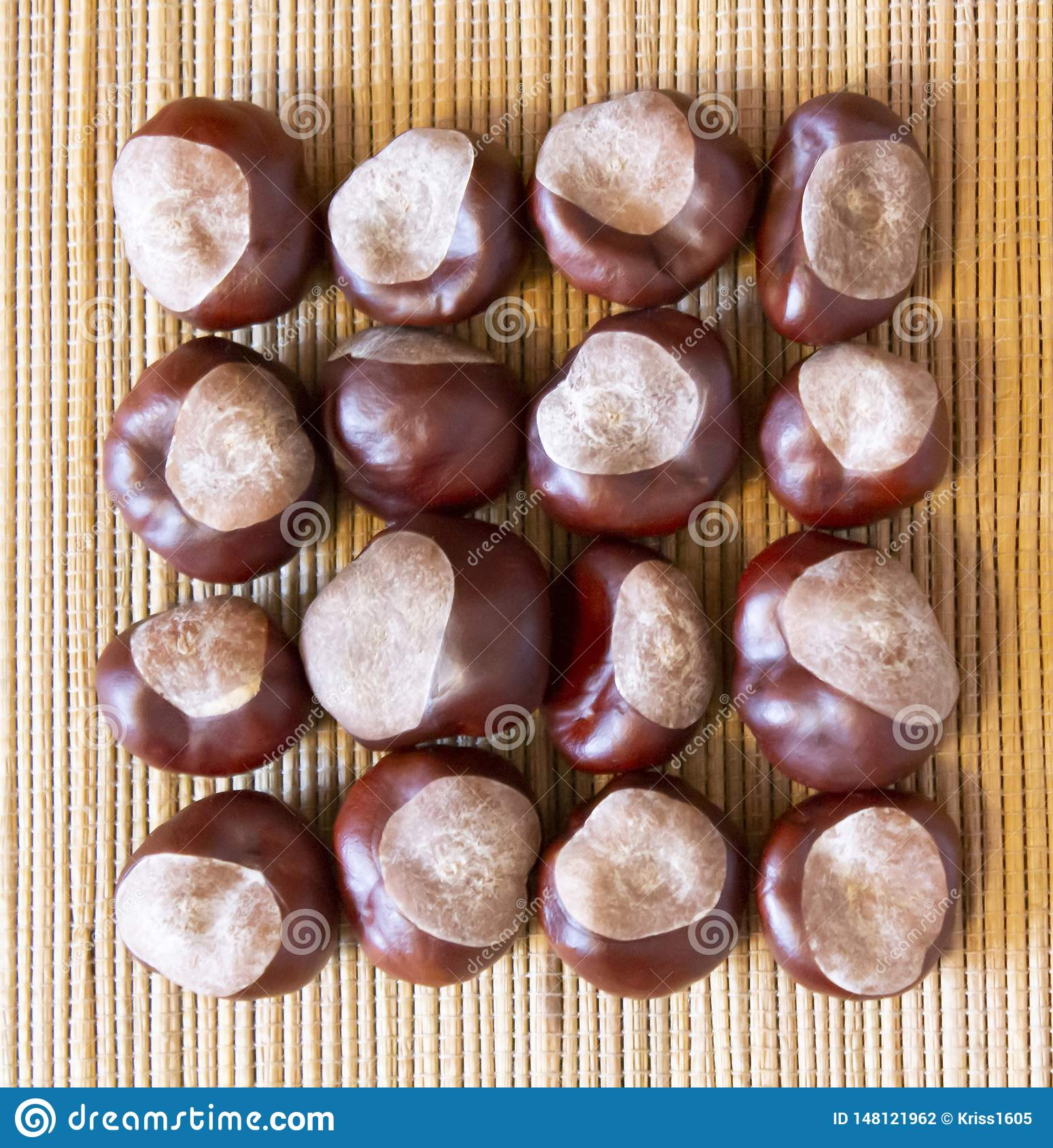a square of peeled chestnuts on a natural brown mat