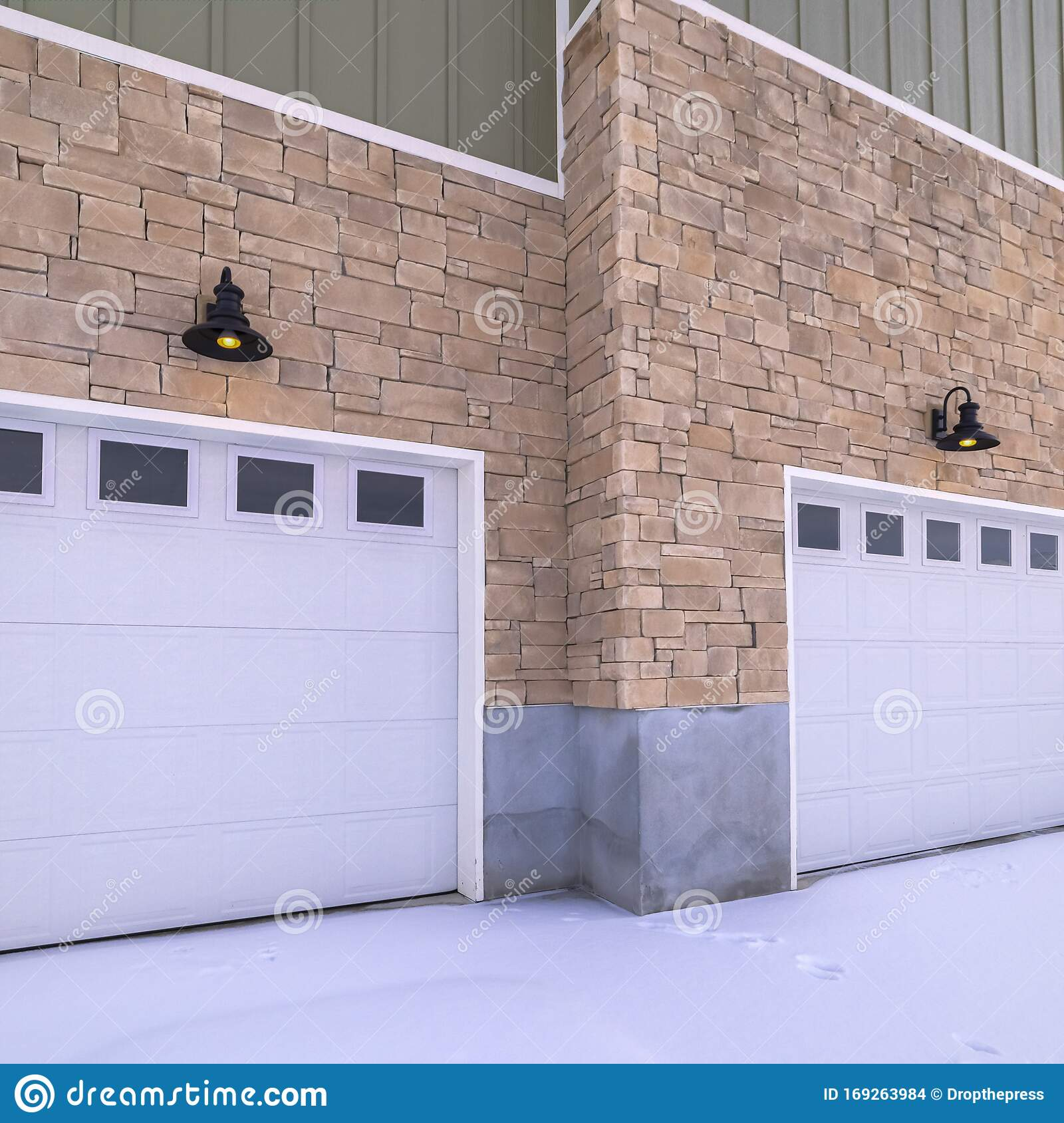 Square Snow Covered Forecourt With Double Garage Doors Stock Photo Image Of Modern Doorway 169263984