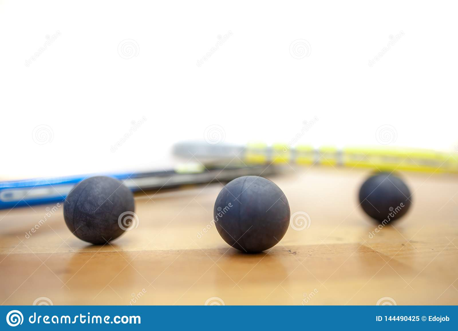 Squash balls scattered on the squash court at the tournament professional player