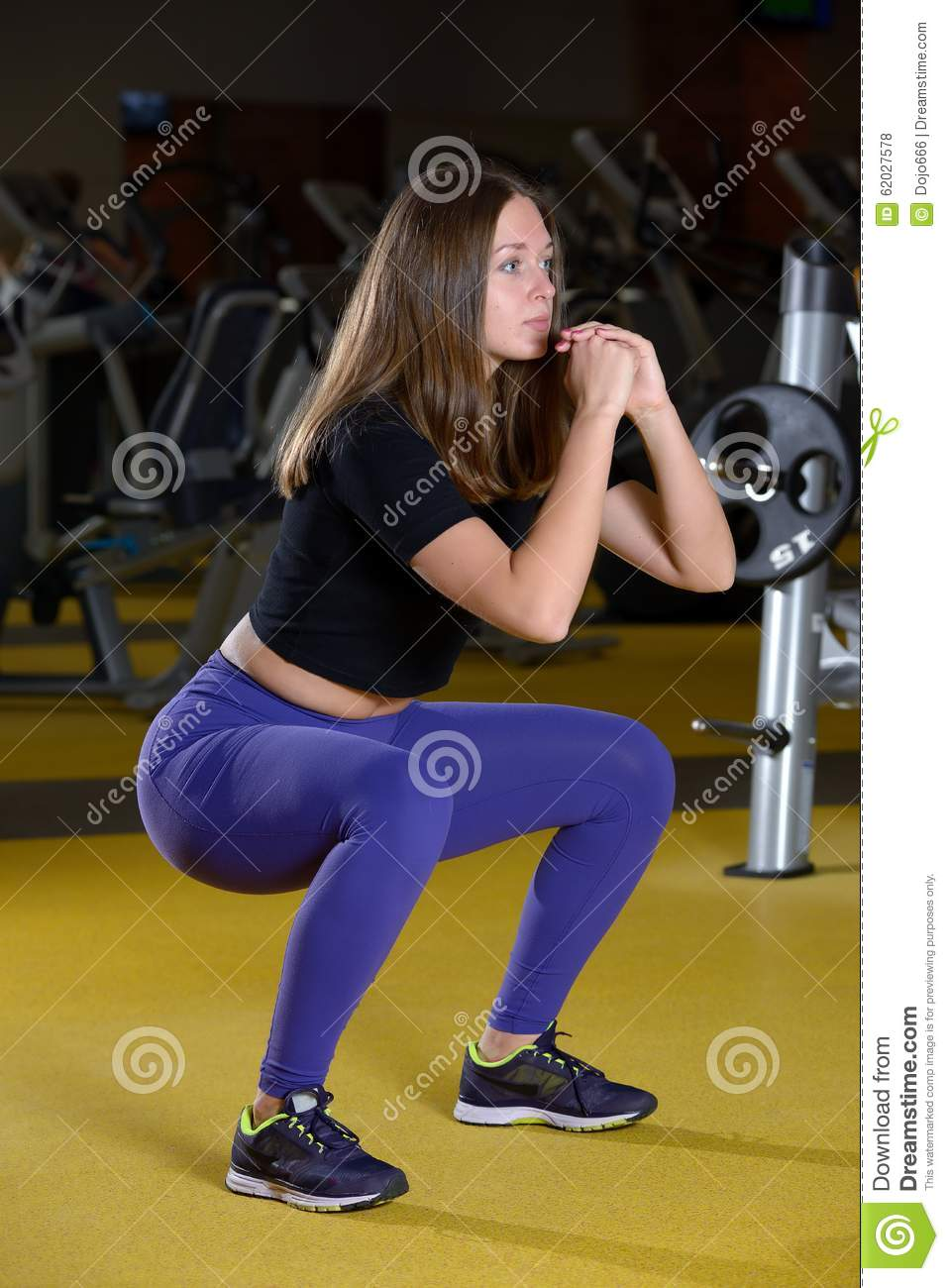 Squat Woman Workout Exercise At Gym Stock Photo - Image of pushup