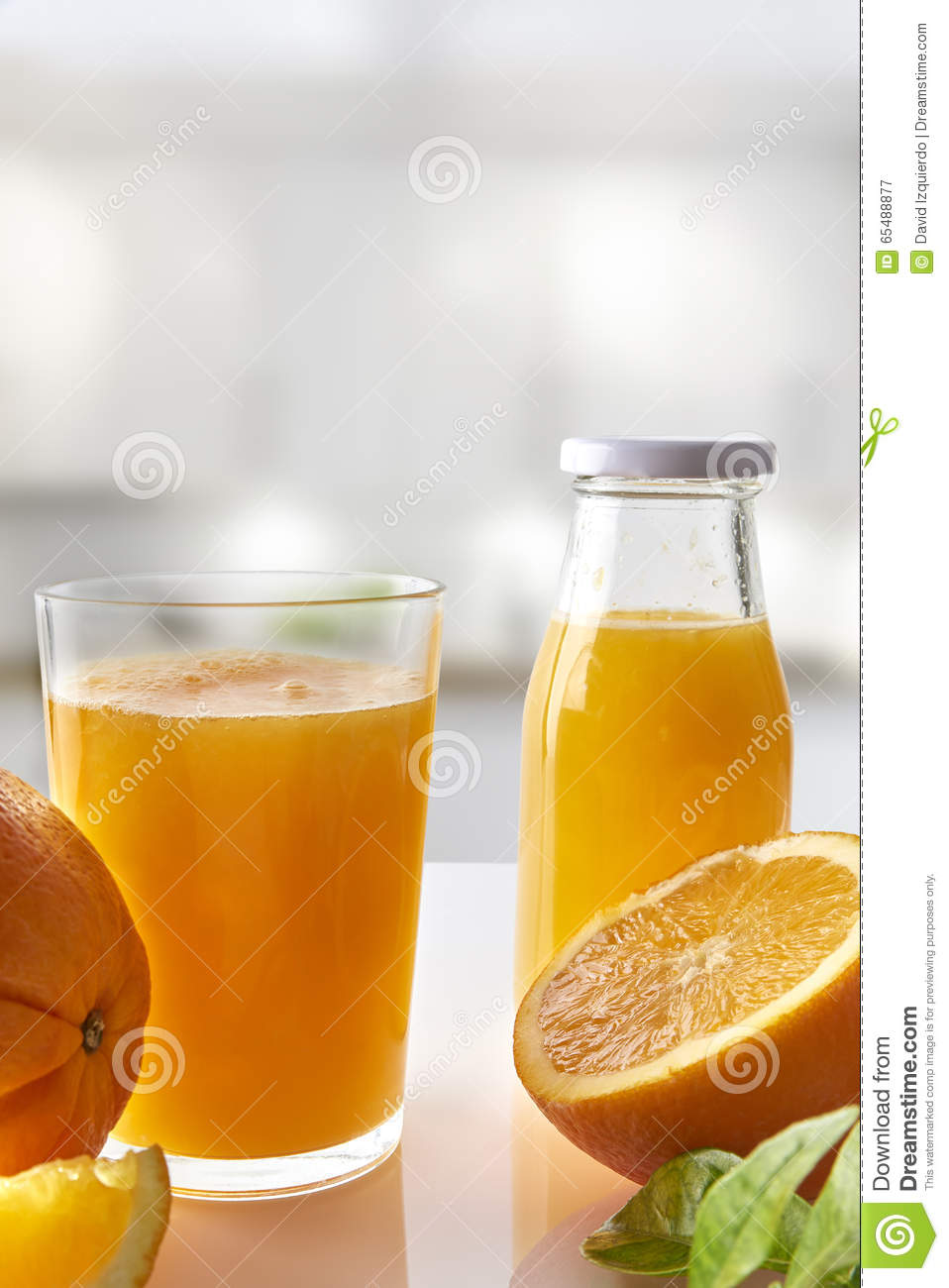 Orange And White Kitchen Squeezed Orange Juice In Glass On White Kitchen Vertical Composi