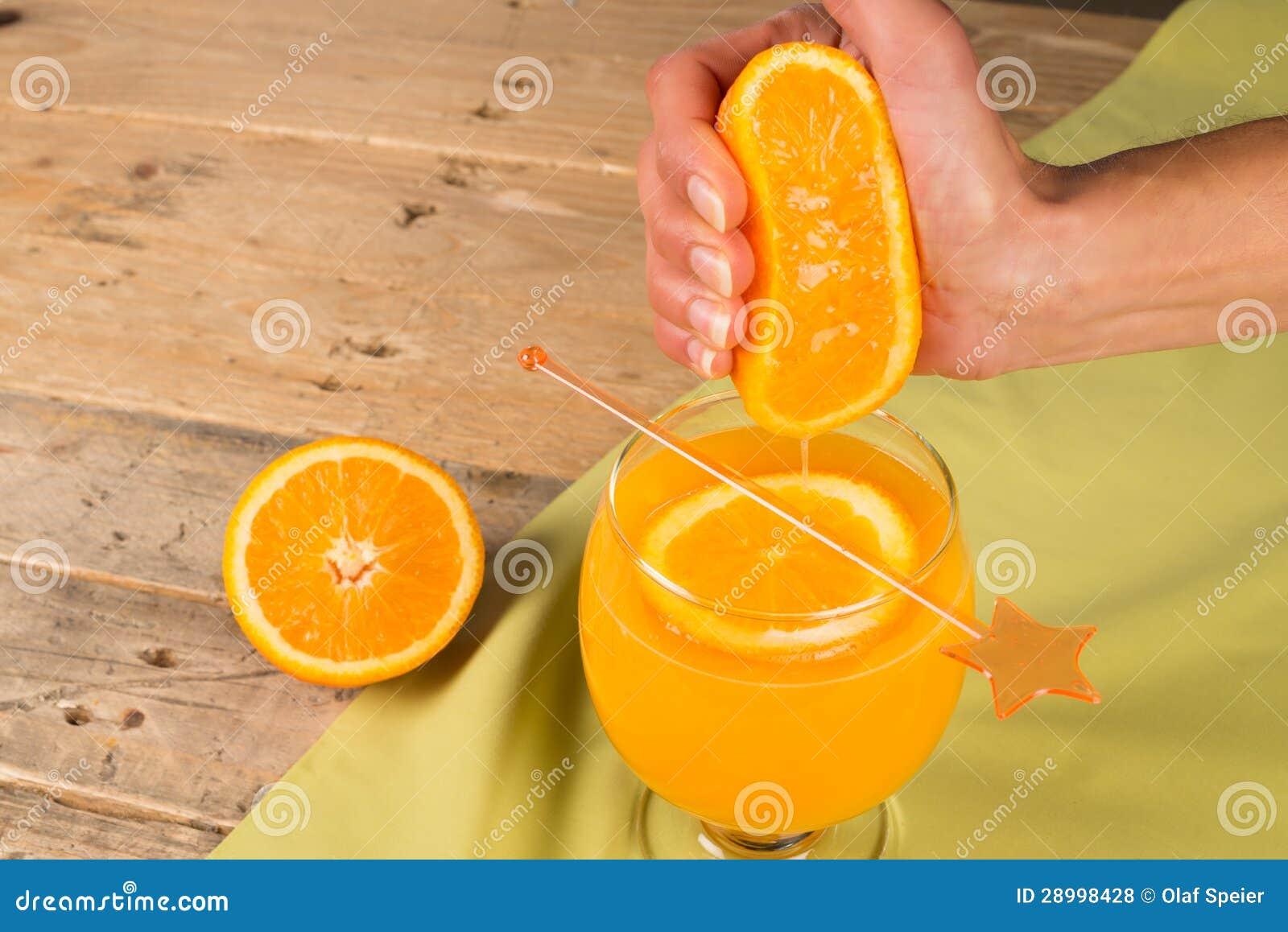 Squeezing natural orange juice