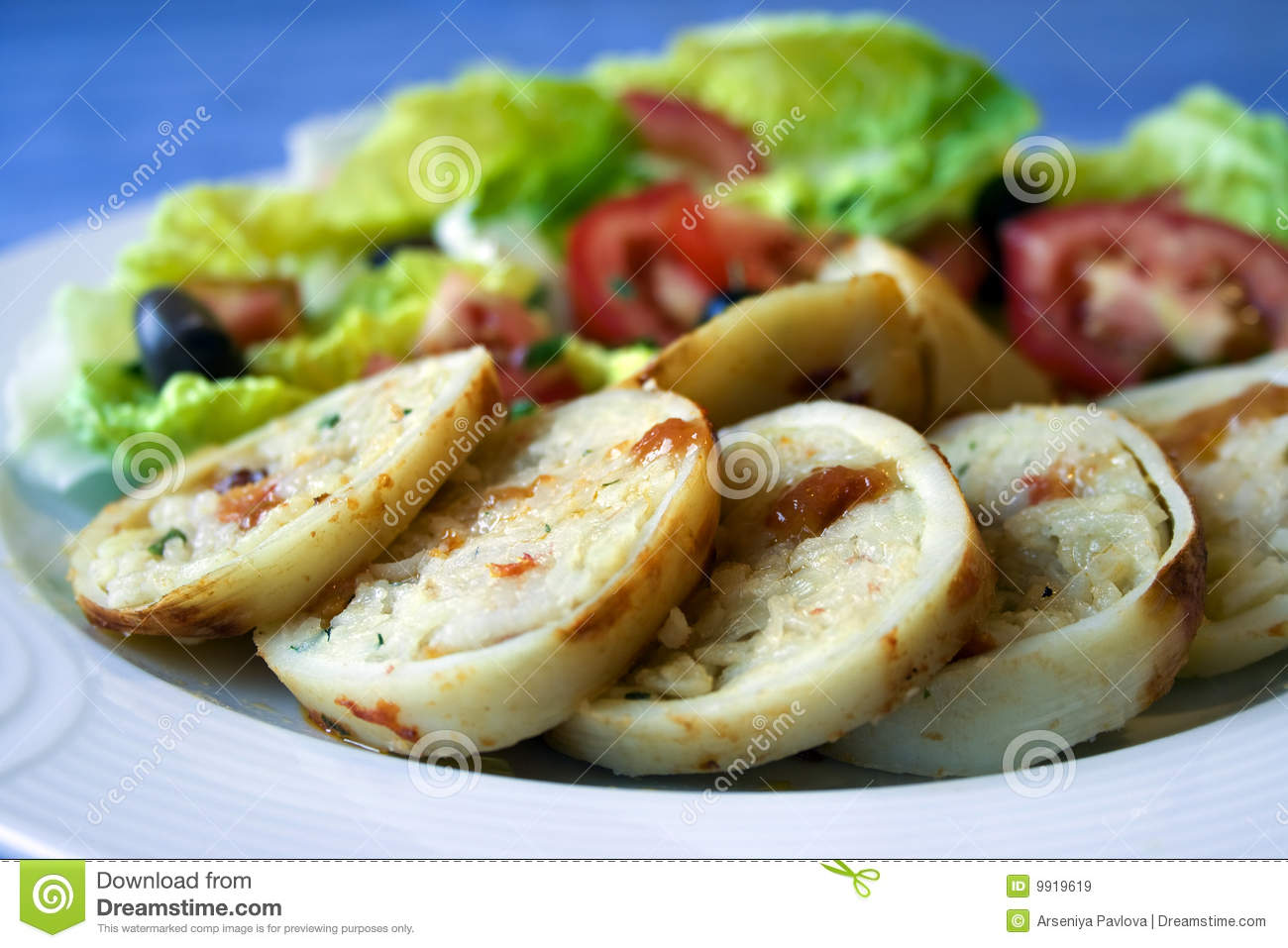 Royalty Free Stock Images: Squid stuffed with rice and greek salad