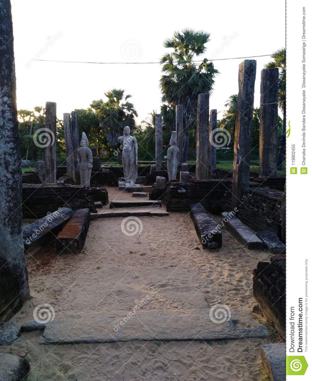 Historical srilankan ruins of a Buddhist stratus build on the sandy surface