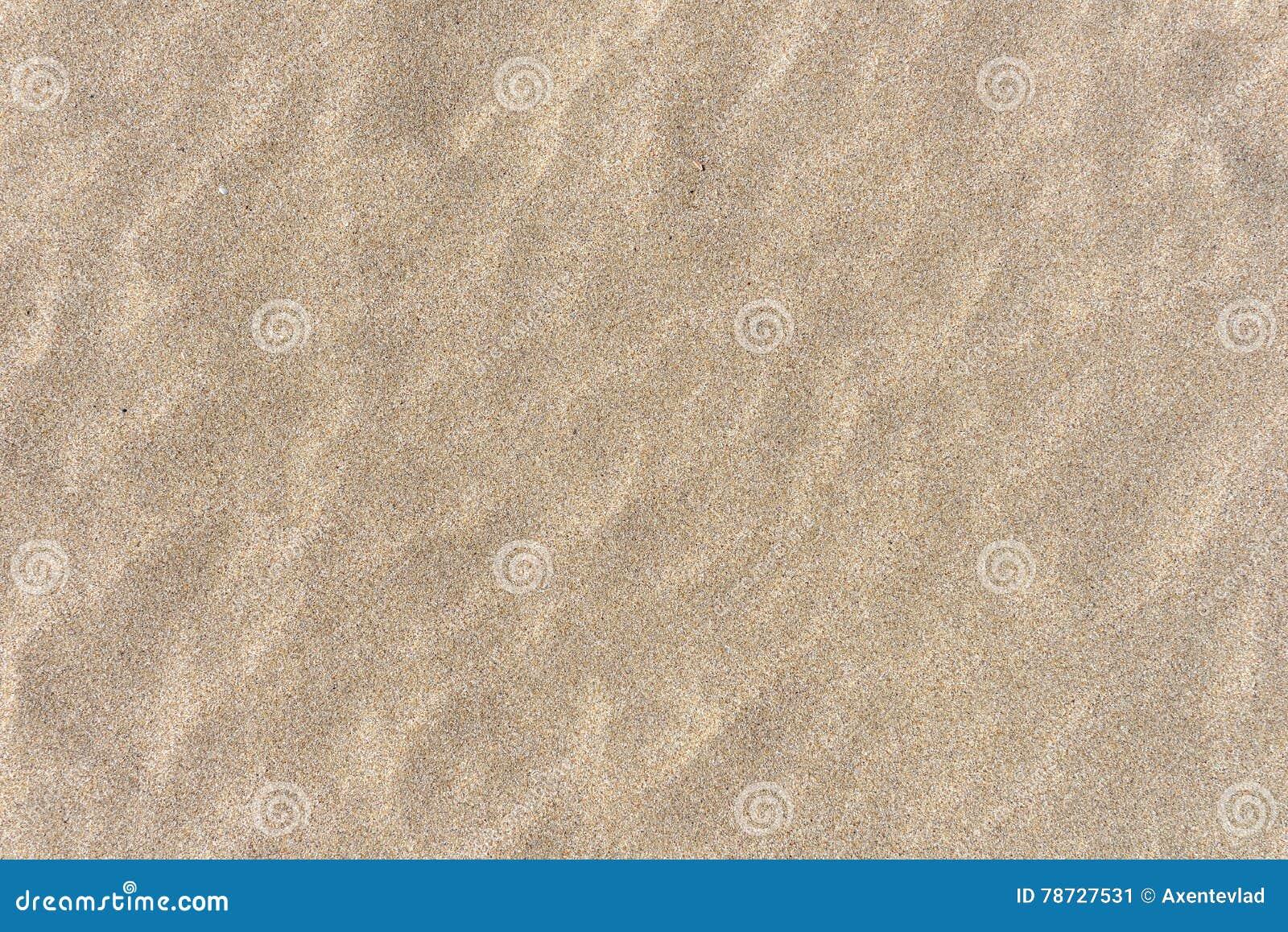 Stäng sig upp av sand på en strand, bakgrund för sandig strand