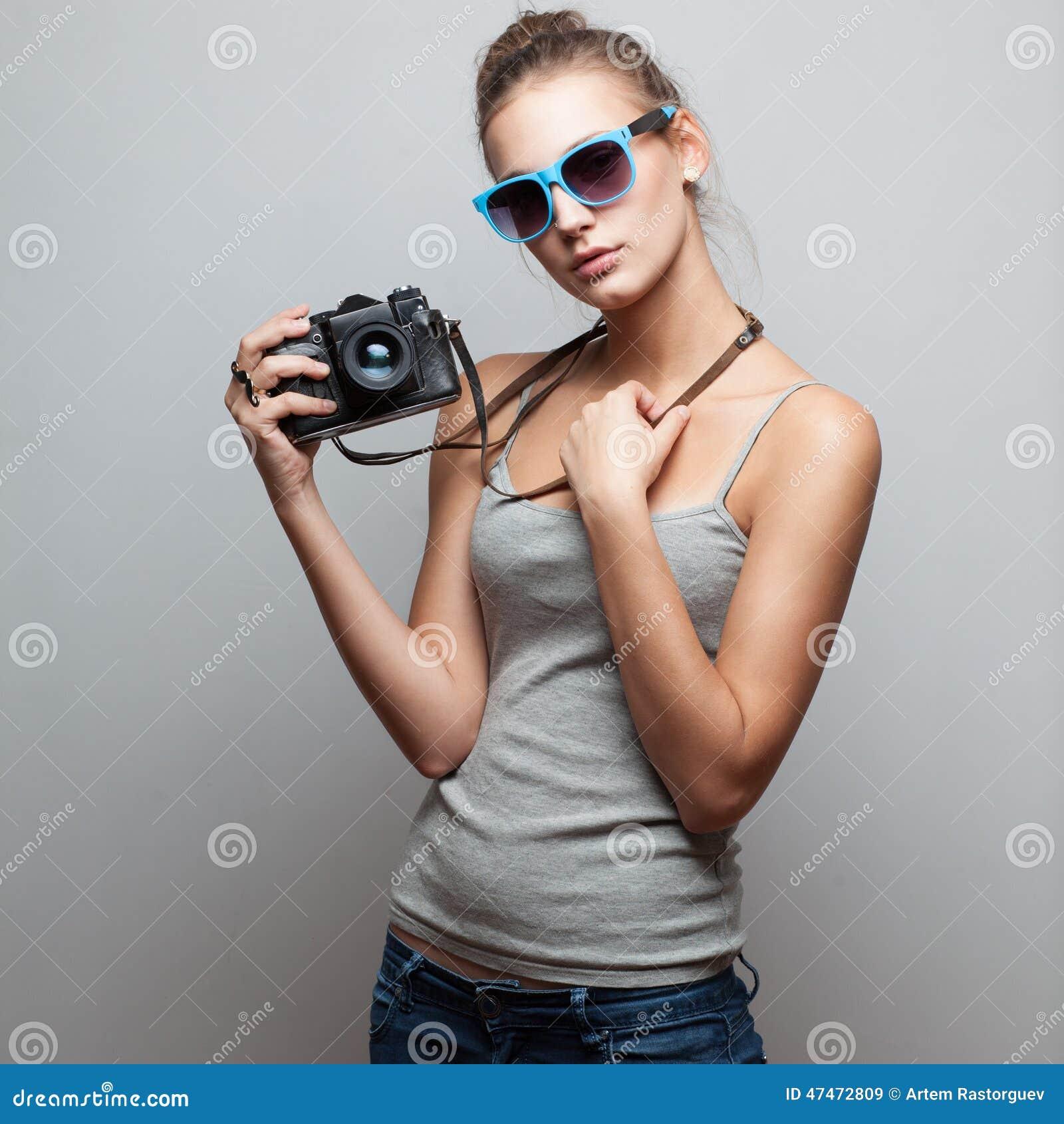Stående av den kvinnliga fotografen