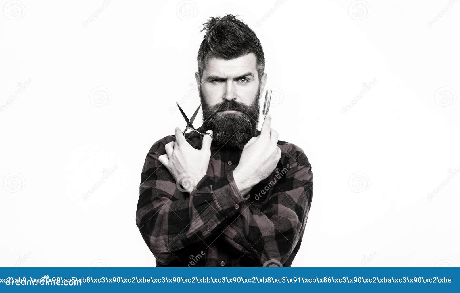 Stående av det stilfulla manskägget Barberaresaxen och den raka rakkniven, barberare shoppar Skäggig man, skäggig man Tappning