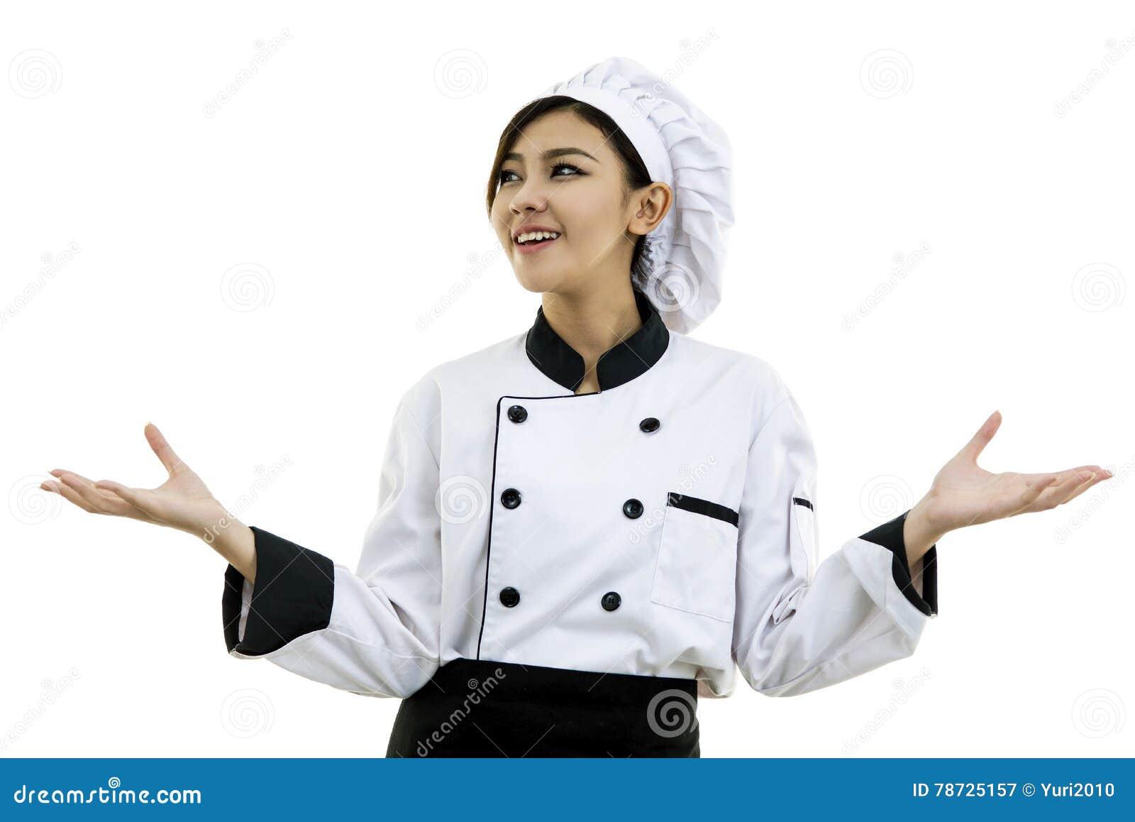 Stående av kocken för ung kvinna på vit bakgrund