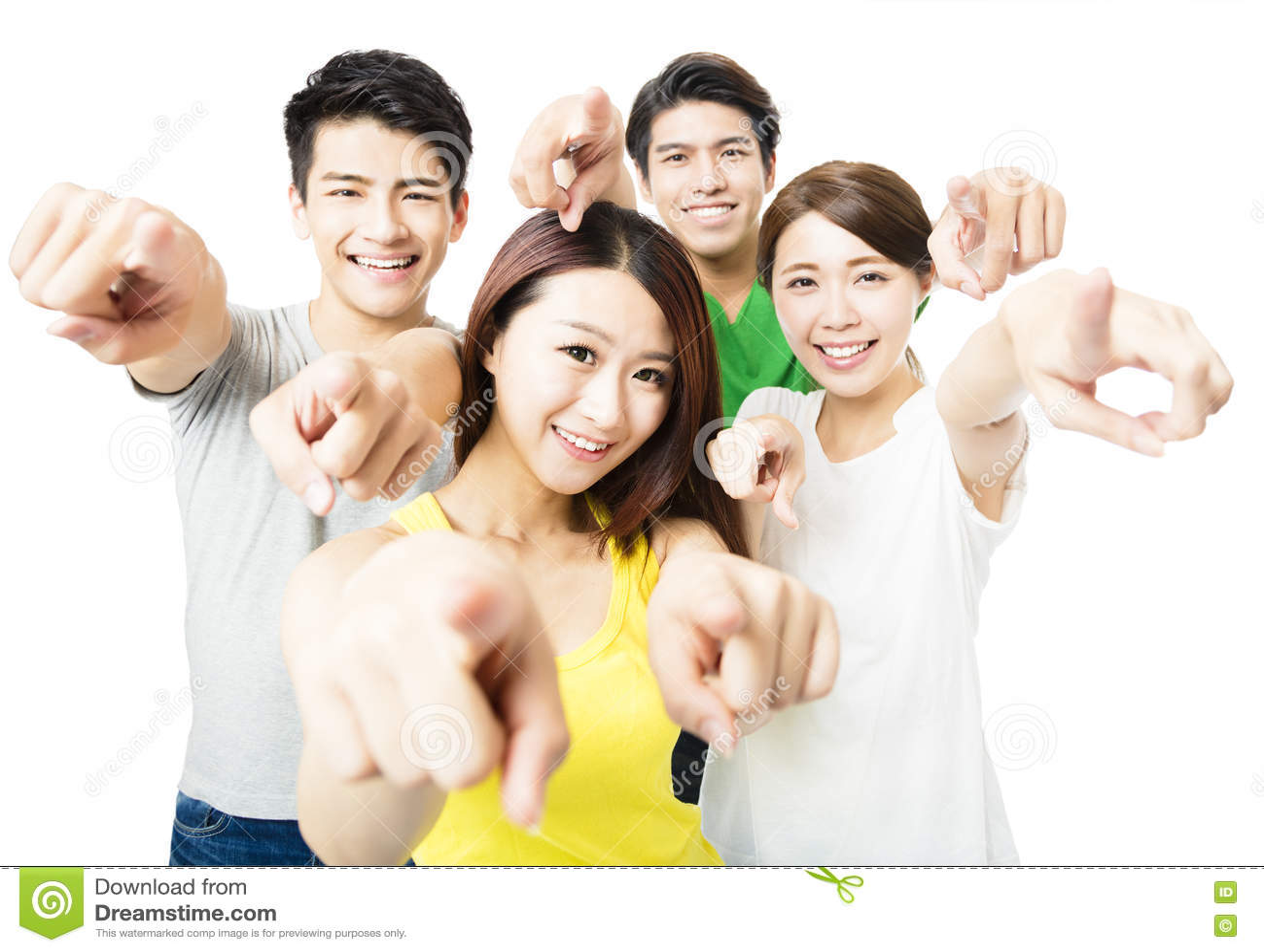 Stående av upphetsat ungt studentfolk som pekar på dig